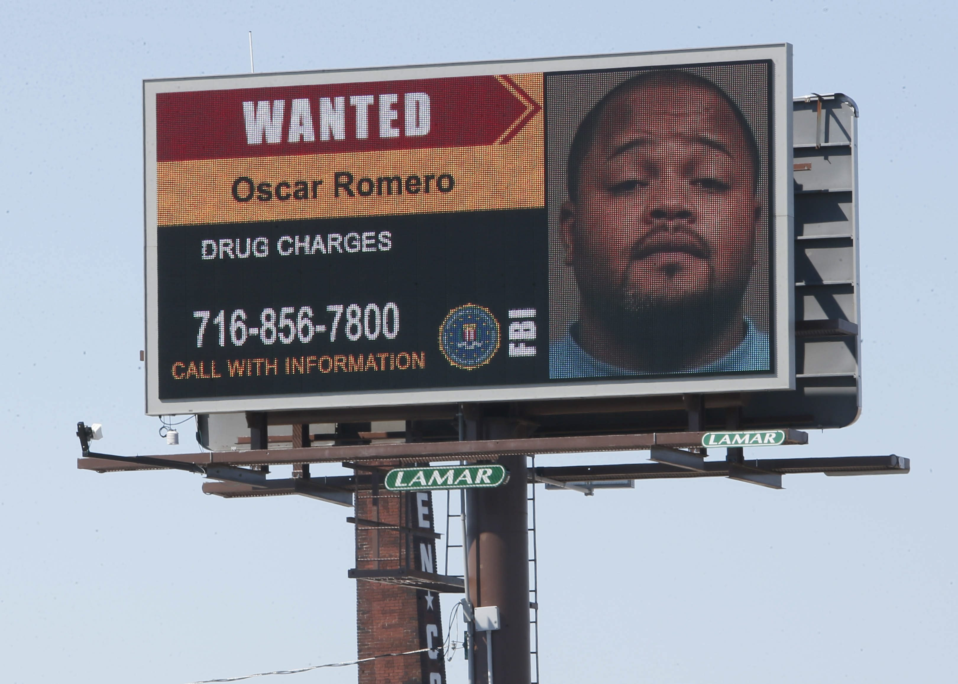 The FBI is using this billboard to enlist help from the community in locating drug suspect Oscar Romero, who is believed to have recently returned to the area from Puerto Rico.