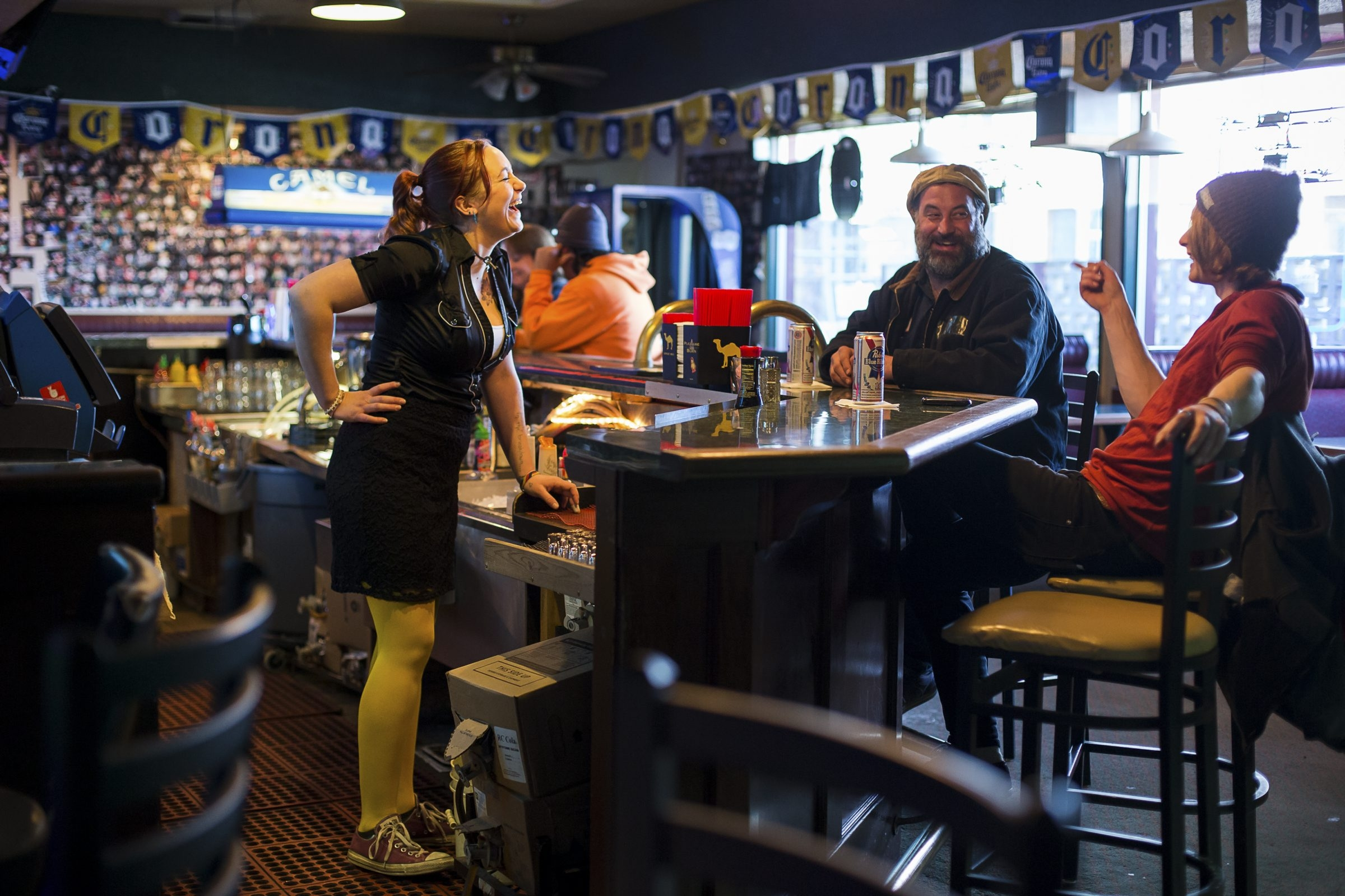 Camille Perry, 26, shown here working at one of her two jobs in Portland, Ore., says members of her generation are basically lazy because they grew up in front of a television playing video games.