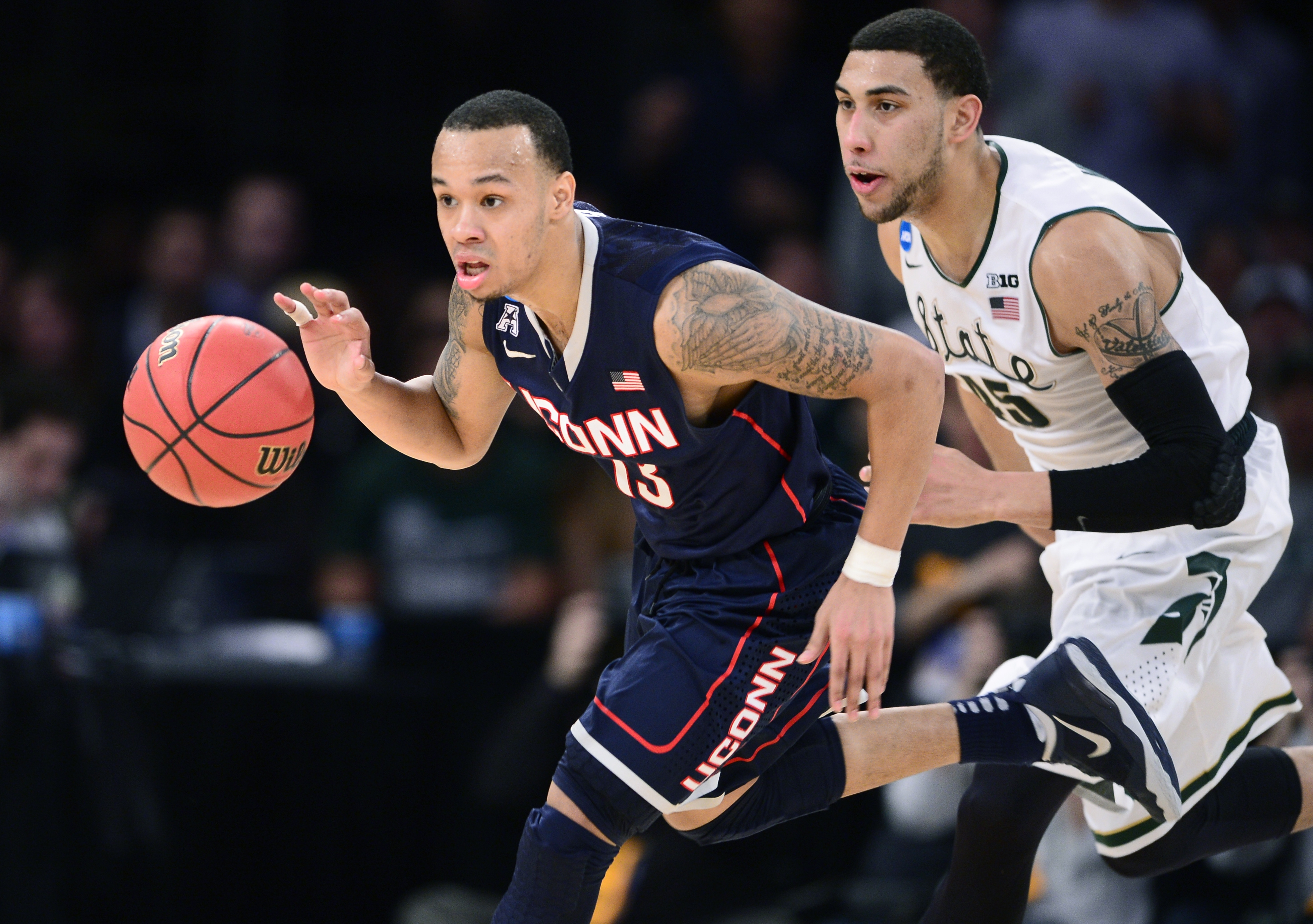 Connecticut point guard Shabazz Napier, charging past Michigan State's Denzel Valentine, led all scorers with 25 points Sunday and was named most outstanding player of the regional.