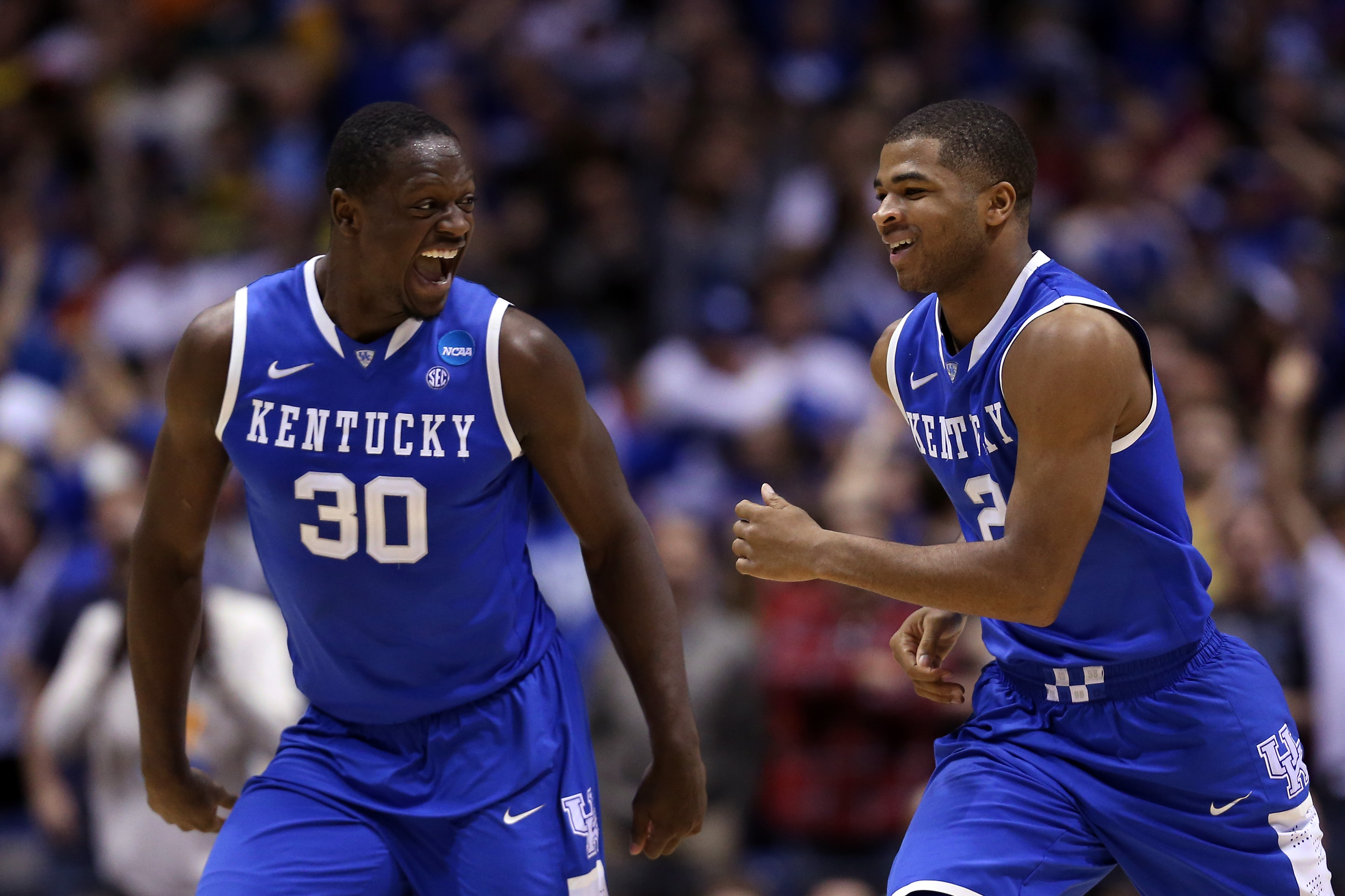 INDIANAPOLIS, IN - MARCH 30:  Aaron Harrison #2 of the Kentucky Wildcats celebrates with teammate Julius Randle #30 after defeating the Michigan Wolverines 75 to 72 in the midwest regional final of the 2014 NCAA Men's Basketball Tournament at Lucas Oil Stadium on March 30, 2014 in Indianapolis, Indiana.  (Photo by Jonathan Daniel/Getty Images)