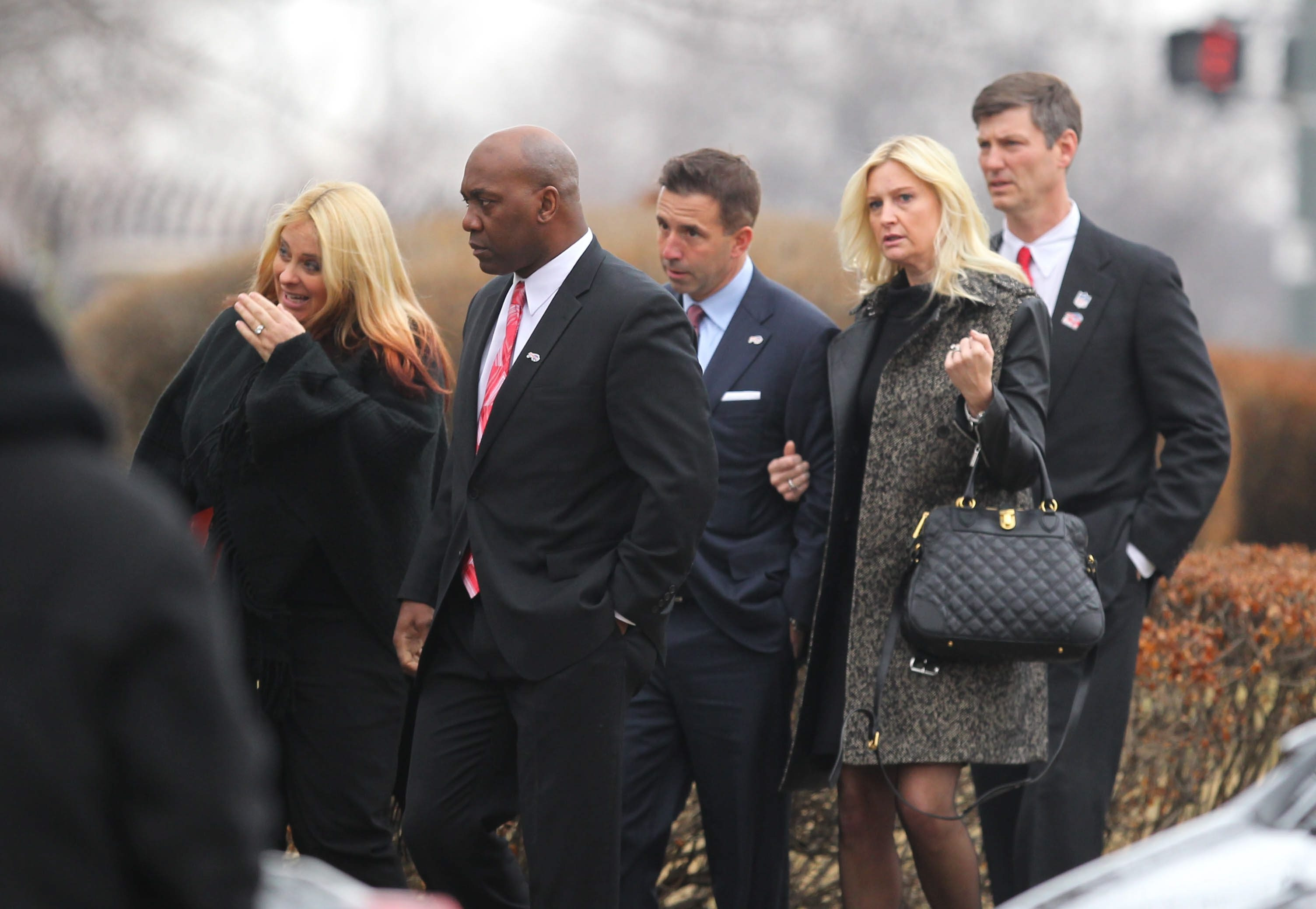 Mourners including Thurman Thomas, left, Russ Brandon, center, and John Marzo, right, arrive for the funeral of Ralph C. Wilson Jr. on Saturday at the Jefferson Avenue Presbyterian Church in Detroit.