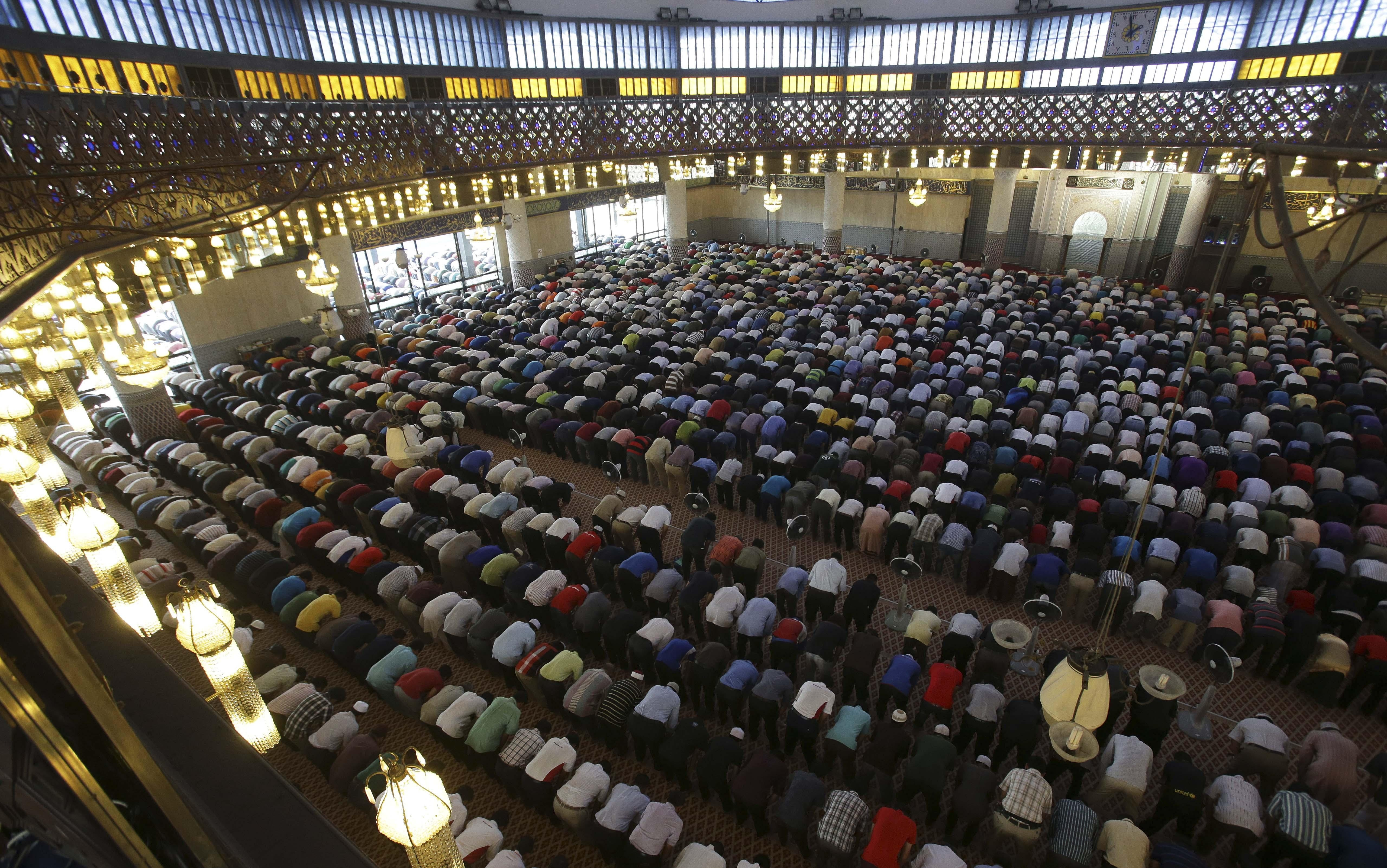 Muslims attend Friday prayers at a mosque in Kuala Lumpur, Malaysia, where they prayed for the passengers and crew of the missing Malaysia Air Flight 370.