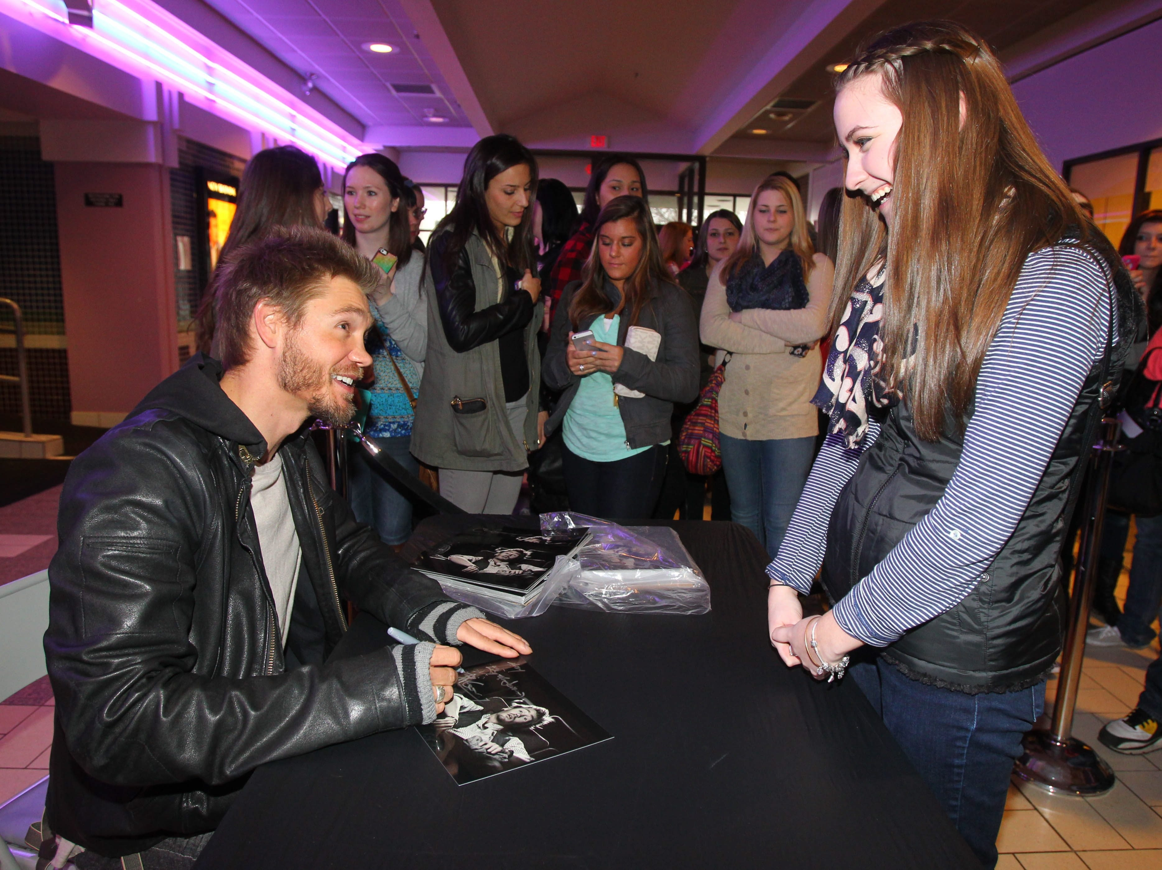 Chad Michael Murray signs an autograph for Mady Loiacano, one of the many fans who came to see him in Eastern Hills Mall on Friday.