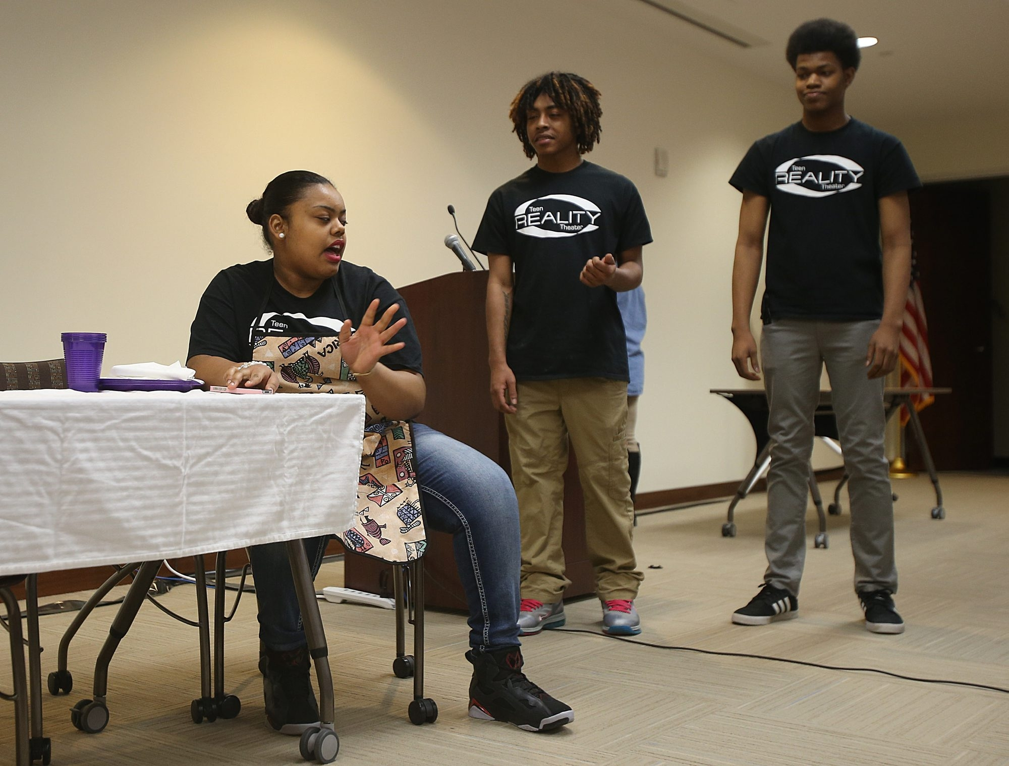 "Teen ""Reality"" Theater actors, from left,  India Hector, 15, as ""Mom""; Raheem Rogers, 17, as ""Jacob""; and Galen Powell, 16, as ""Terrell,"" perform in the BlueCross BlueShield of Western New York headquarters in Buffalo during ""World Without Borders: Embracing Cultural Differences."""