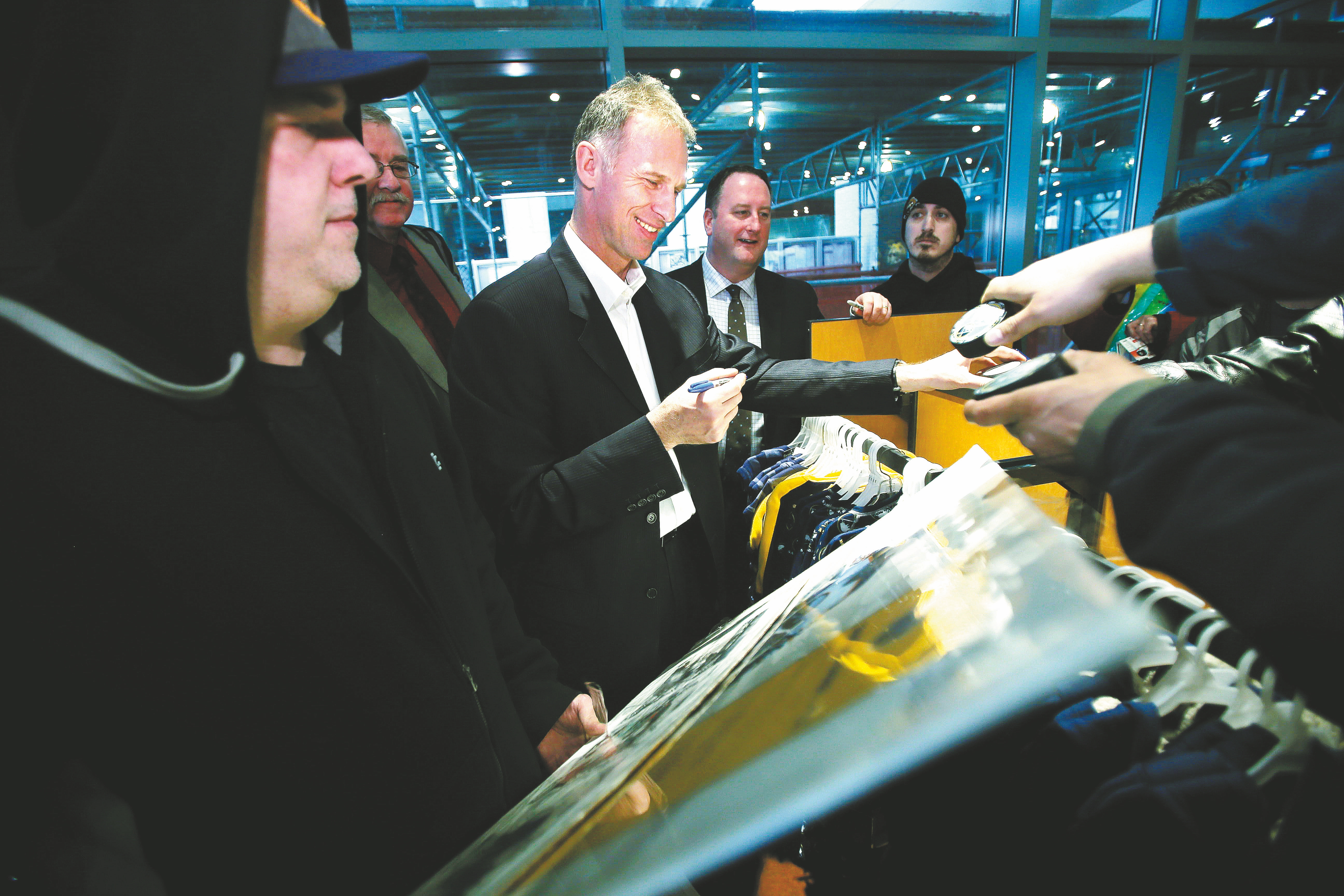 Dominik Hasek signs autographs for fans at the Sabres Store in First Niagara Center on Friday. The team will induct him into its Hall of Fame before tonight's game.