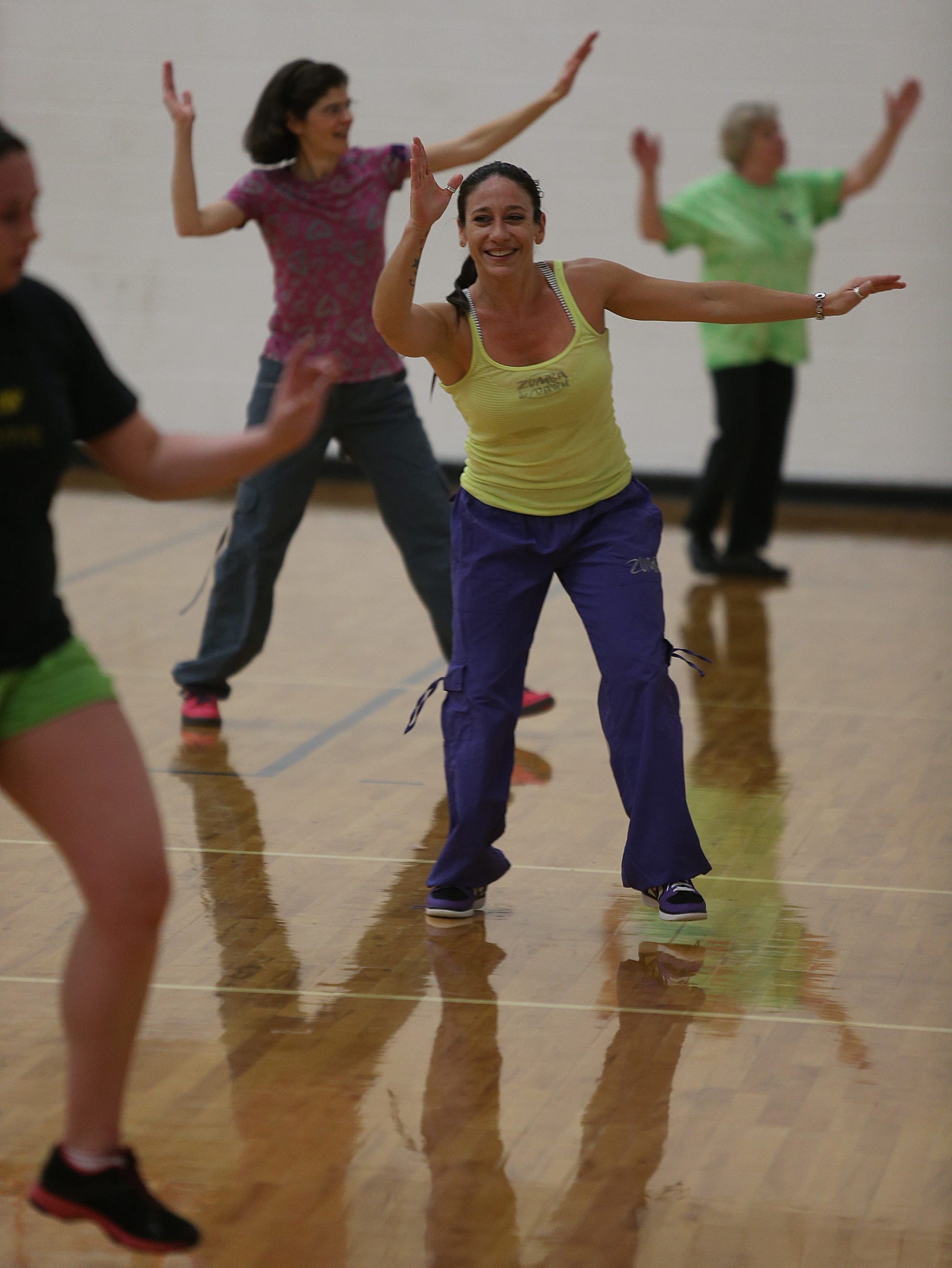 """Dawn Hammer leads a """"Zumba with Dawn"""" session attThe Park School's Rich Family Activity Center in Amherst."""