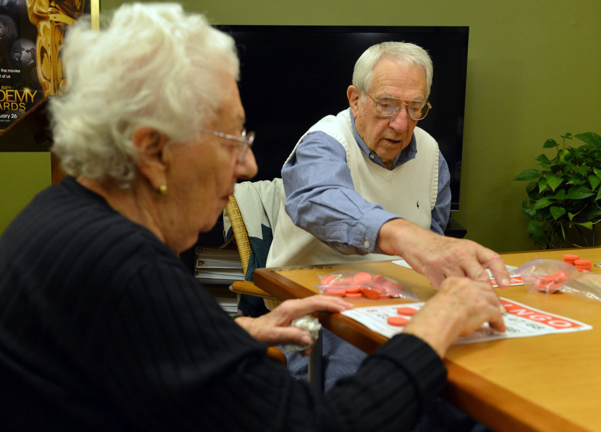 Harry Baron and his wife, Claire, play bingo at Arbor Terrace, an assisted living community in Marietta, Ga. Harry is still active, but his wife requires the assisted care of a nursing home.