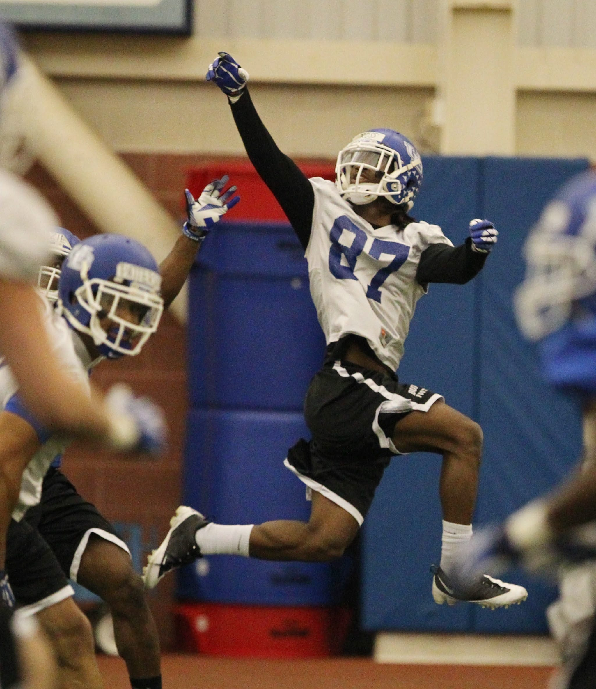 UB wide receiver Boise Ross extends to pull in a pass during the opening day of spring practice.