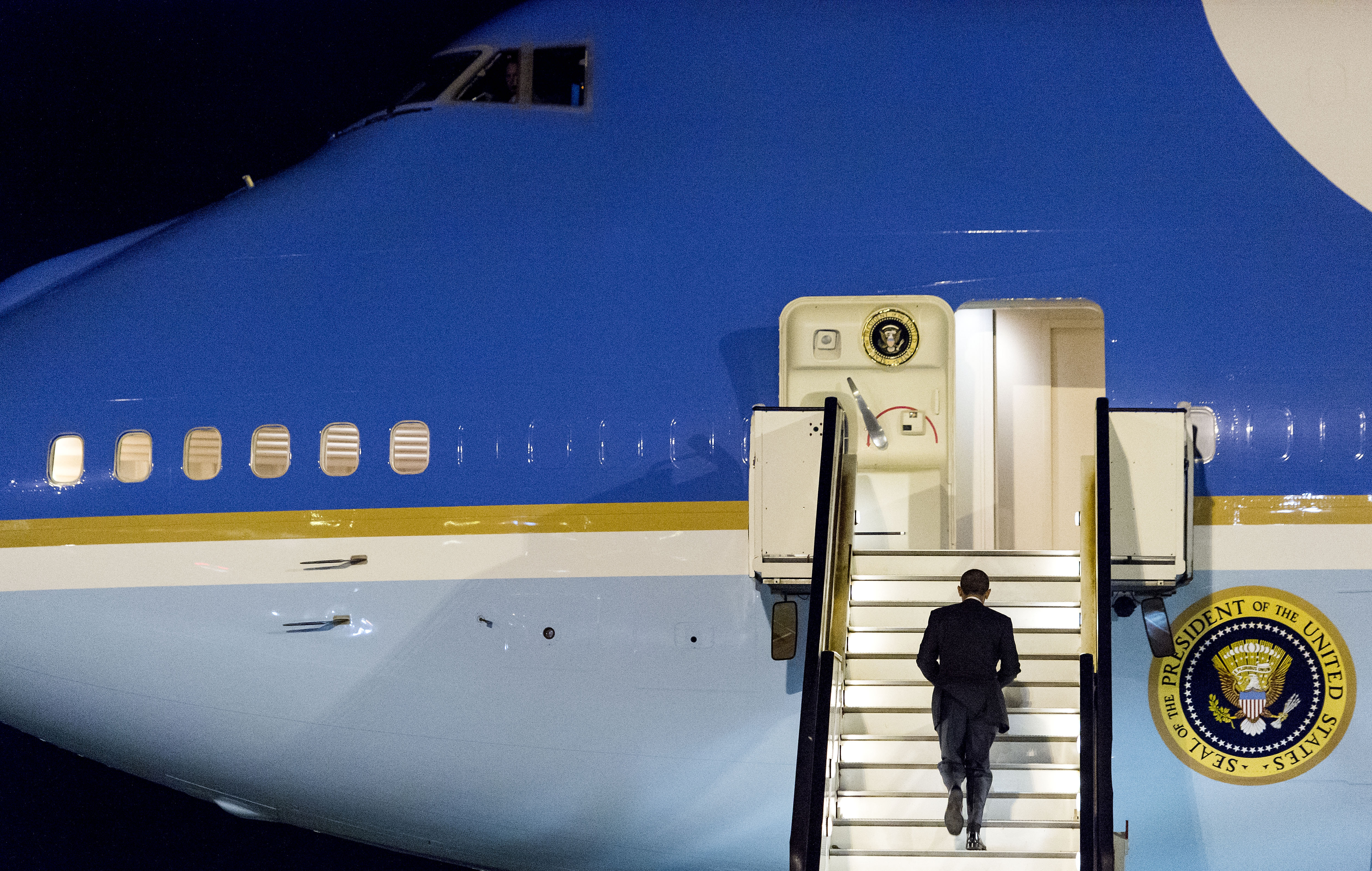 President Obama walks up the stairs of Air Force One before leaving Amsterdam Airport Schiphol on Tuesday. Obama attended a two-day nuclear security summit with more than 50 world leaders in The Hague, Netherlands.