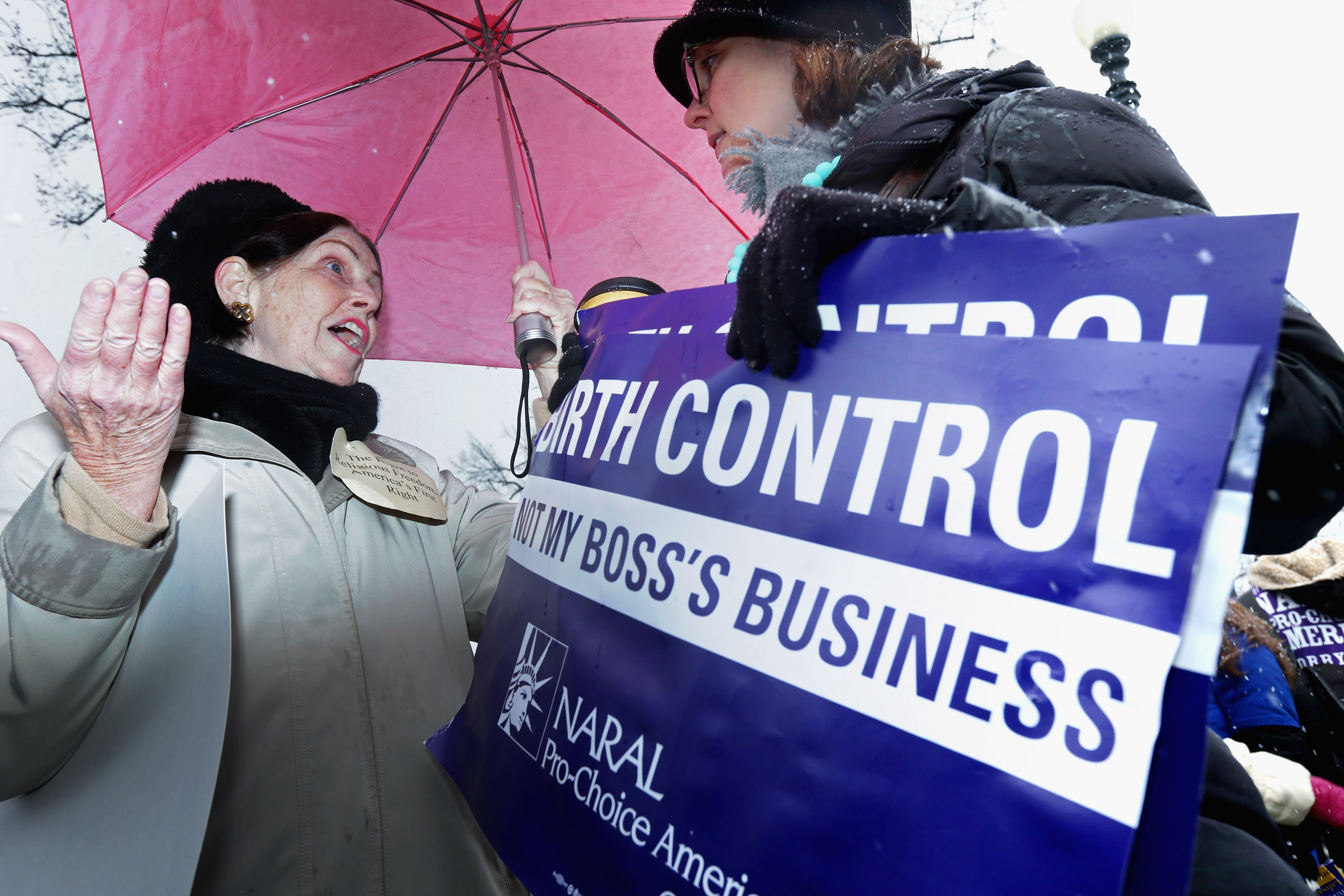 Advocates on opposite sides of the issue debate at rally outside the Supreme Court during oral arguments on birth control coverage.