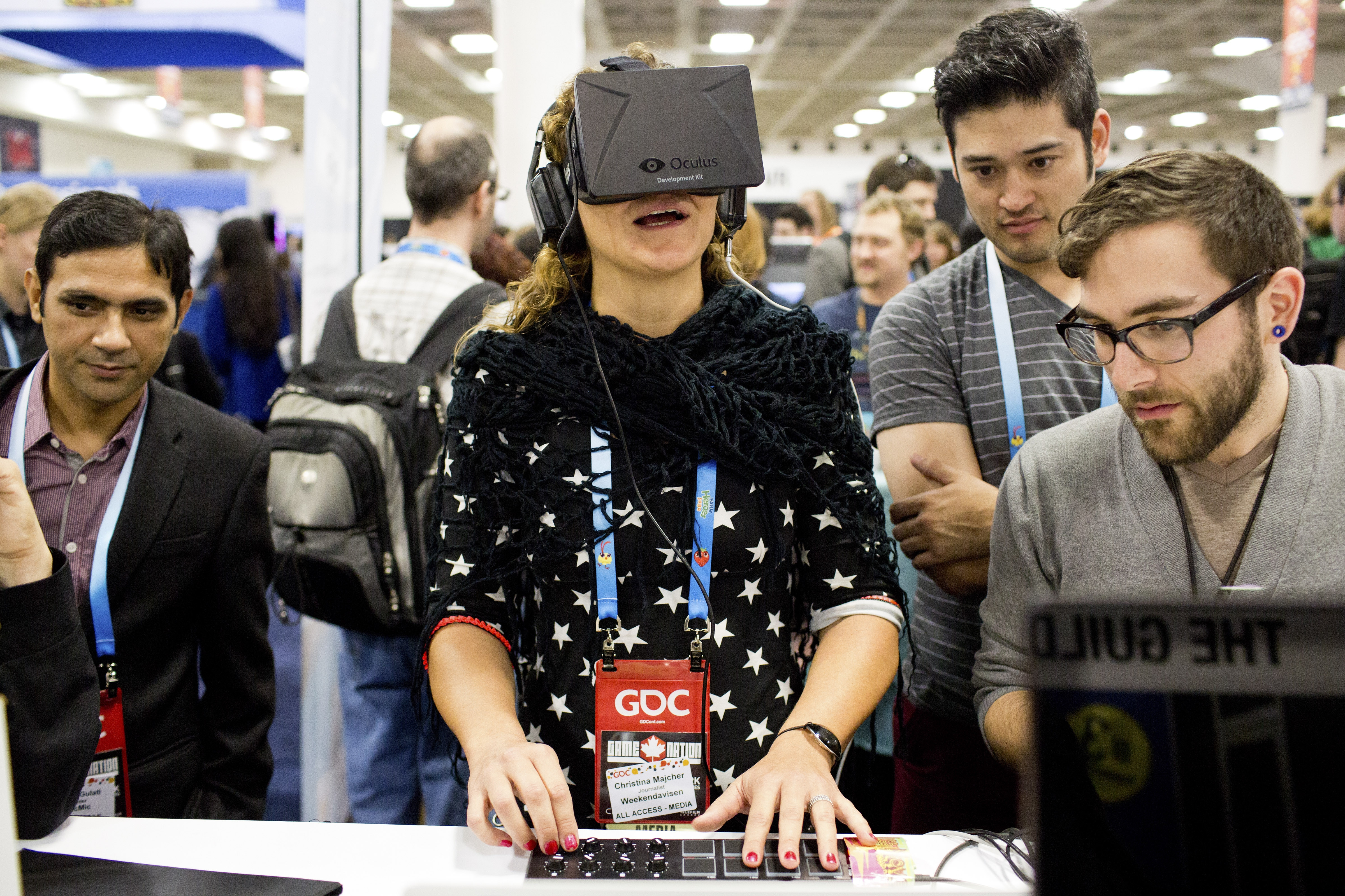 Christina Majcher plays a prototype game using the Oculus VR headset during the Game Developers Conference at the Moscone Center in San Francisco, Calif.