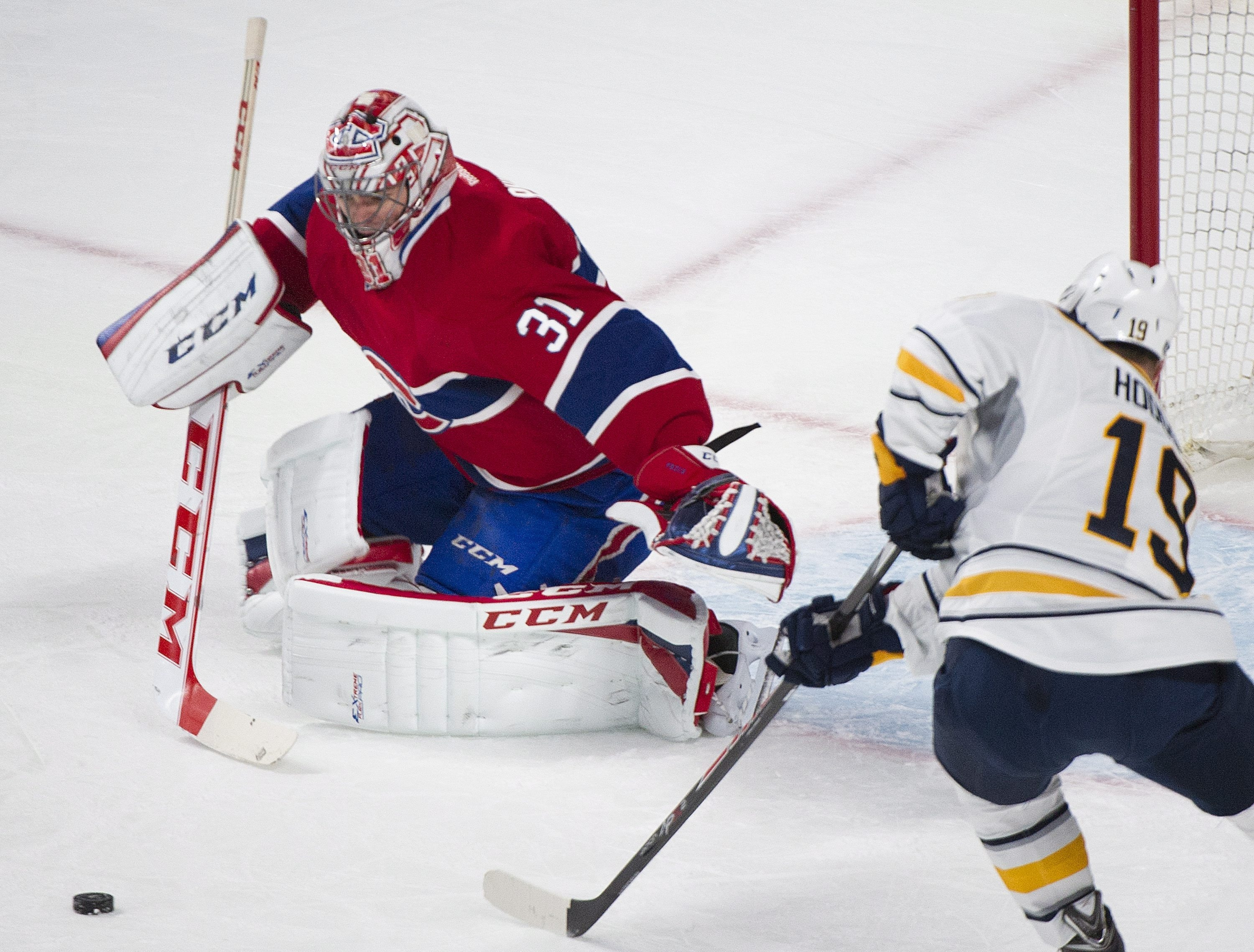 Montreal Canadiens goalie Carey Price makes a save against Cody Hodgson of the Sabres in the first period of Tuesday night's game in the Bell Centre.