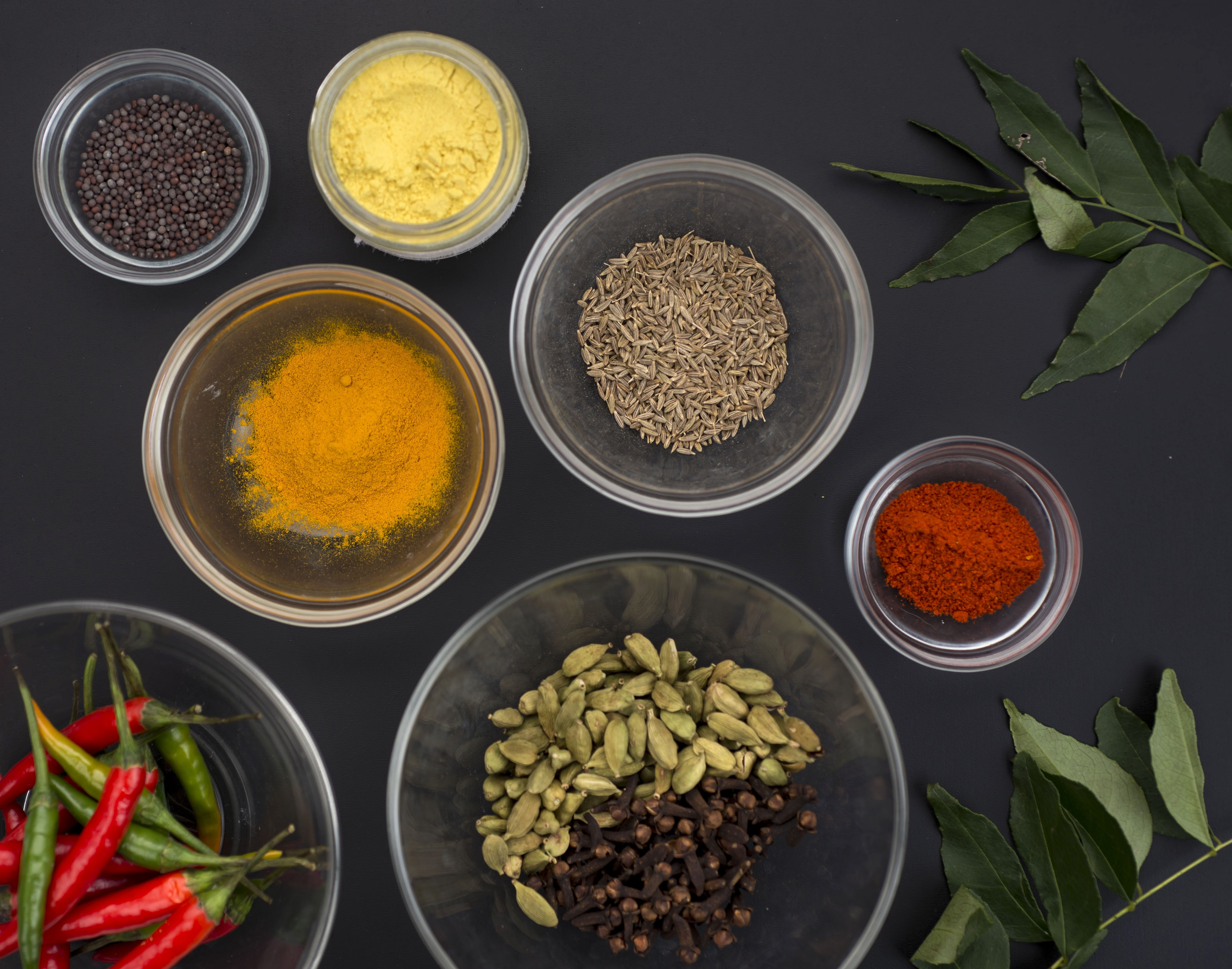 An assortment of spices, including chili peppers, cardamom, cloves, red chilli powder, turmeric, asafetida, cumin seeds, black mustard seeds and curry leaves are vital for preparing dal, the versatile staple made from dried beans.