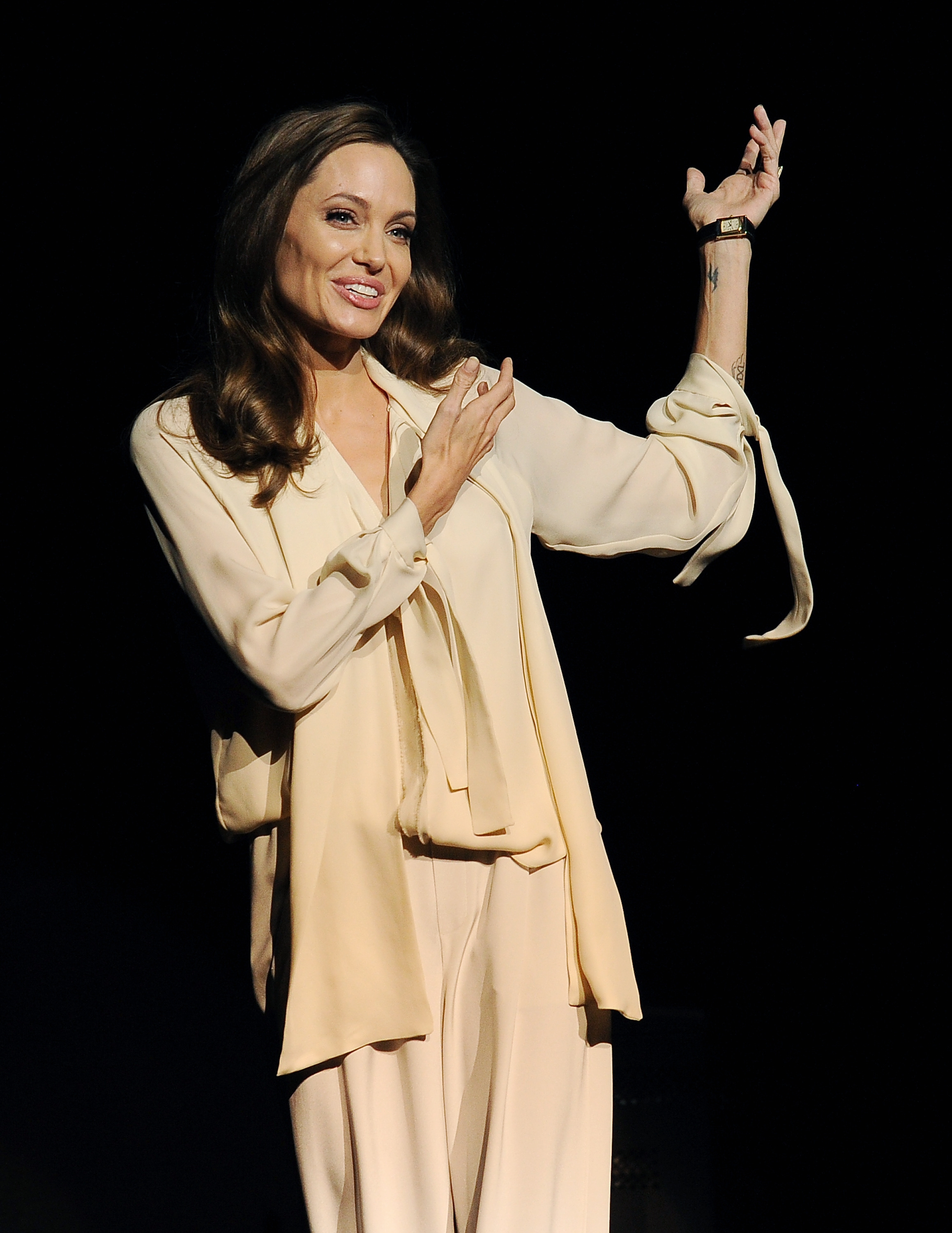 """Unexpected guest: Angelina Jolie made a surprise appearance at the CinemaCon convention in Las Vegas Tuesday to introduce a trailer for """"Unbroken,"""" a movie she directed."""