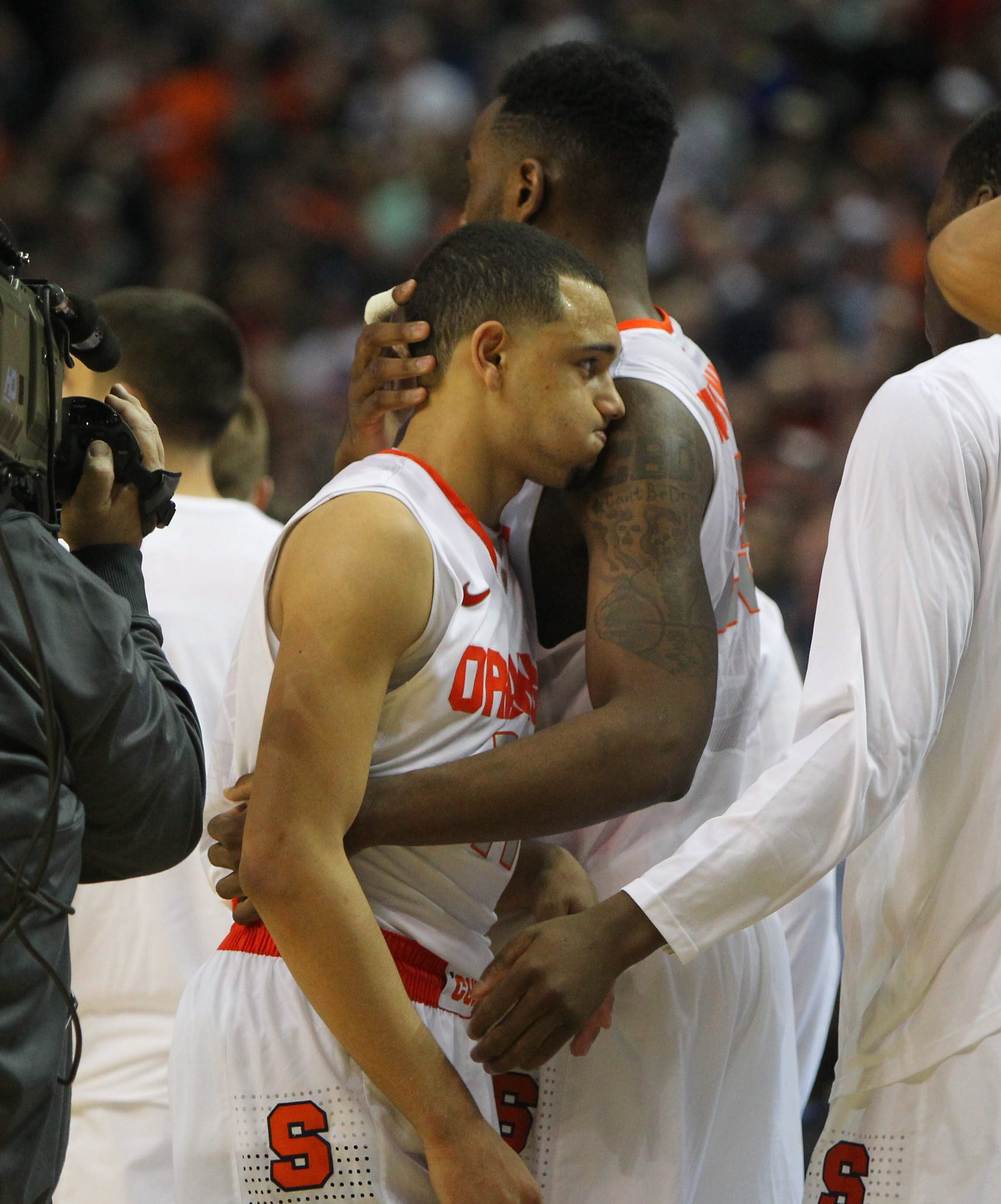 Syracuse's Tyler Ennis is hugged by teammate Rakeem Christmas after Saturday night's 55-53 loss to Dayton. Ennis missed a potential game-winning shot at the buzzer.  ===