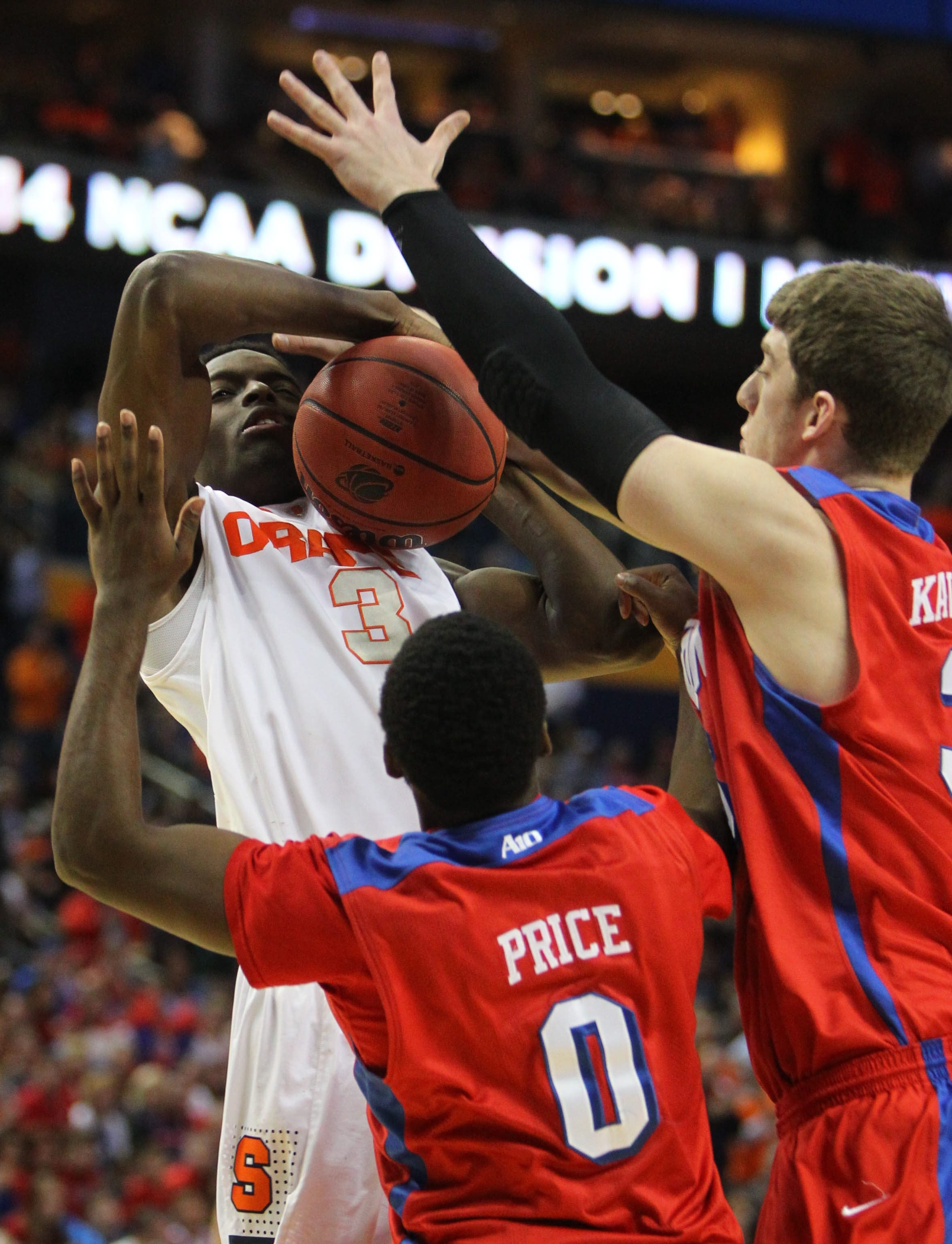 Syracuse's Jerami Grant gets stuffed by Dayton's Khari Price and Matt Kavanaugh in Saturday night's triumph by the 11th-seeded Flyers at First Niagara Center.