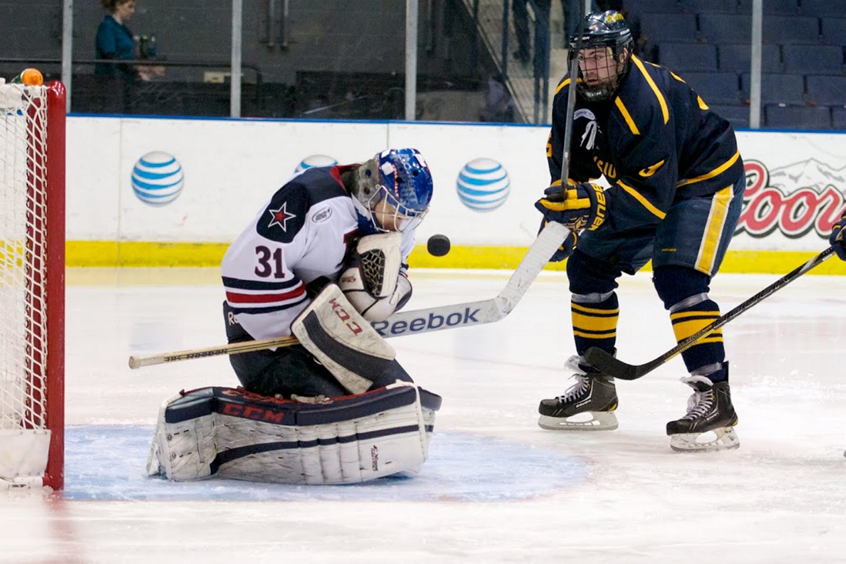 Robert Morris goaltender Dalton Izyk stops Canisius' Taylor Law for one of his 27 saves Saturday at Blue Cross Arena.