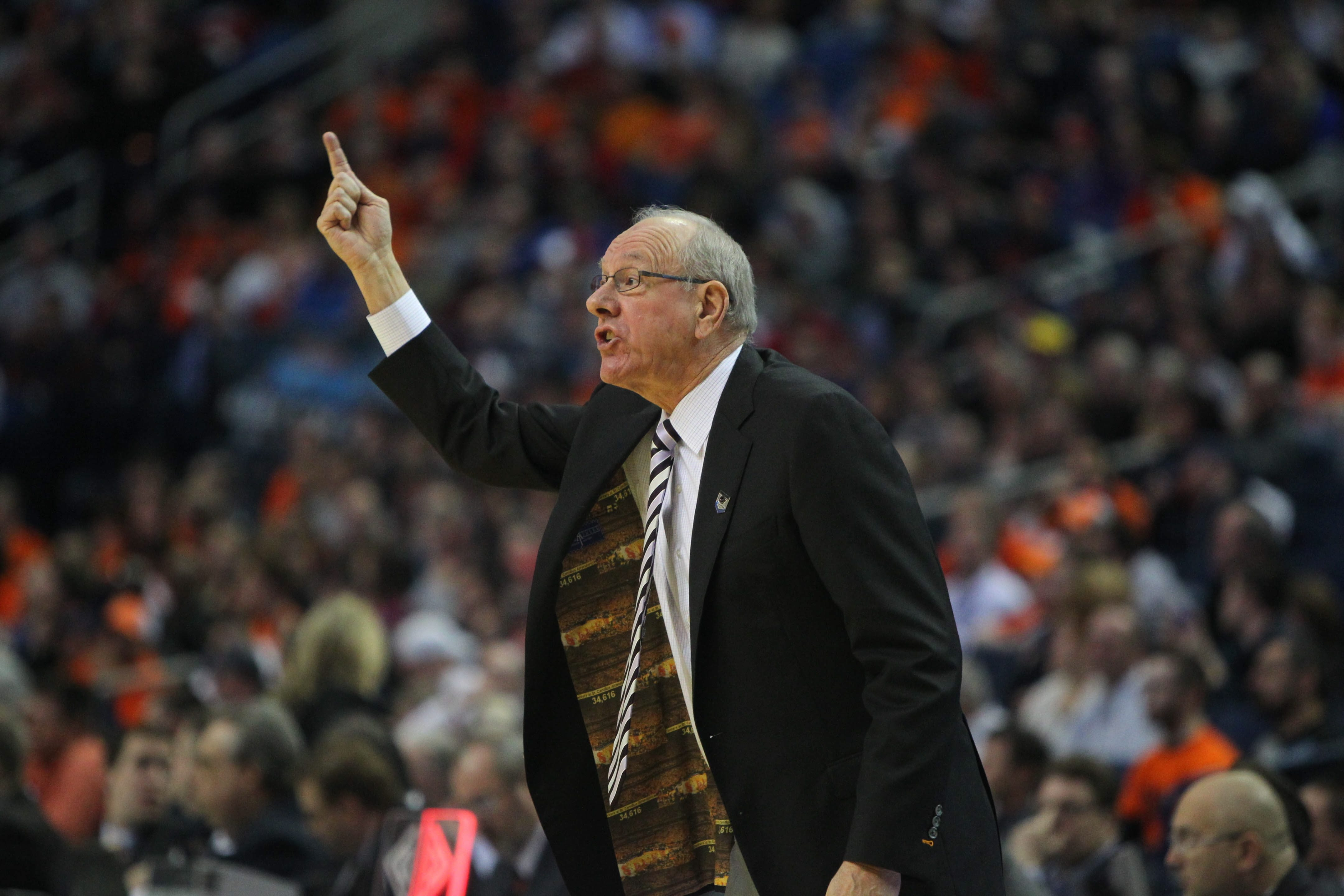 Syracuse coach Jim Boeheim gestures to his players during the third-round game against Dayton on Saturday.