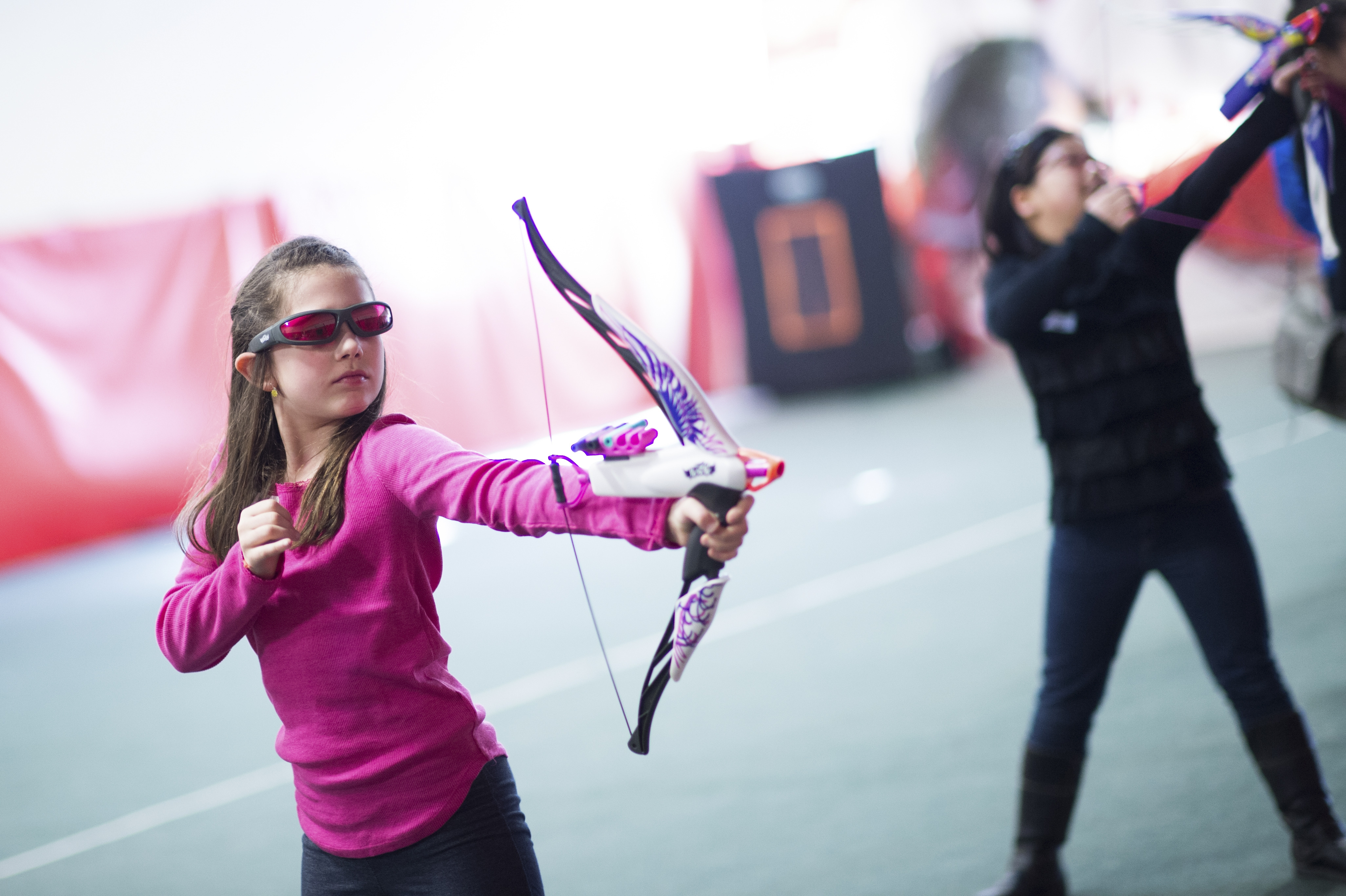 Mackenzie Medeiros, 9, tests the Nerf Rebelle Agent Bow at a facility near the Hasbro Headquarters in Pawtucket, R.I., last week.