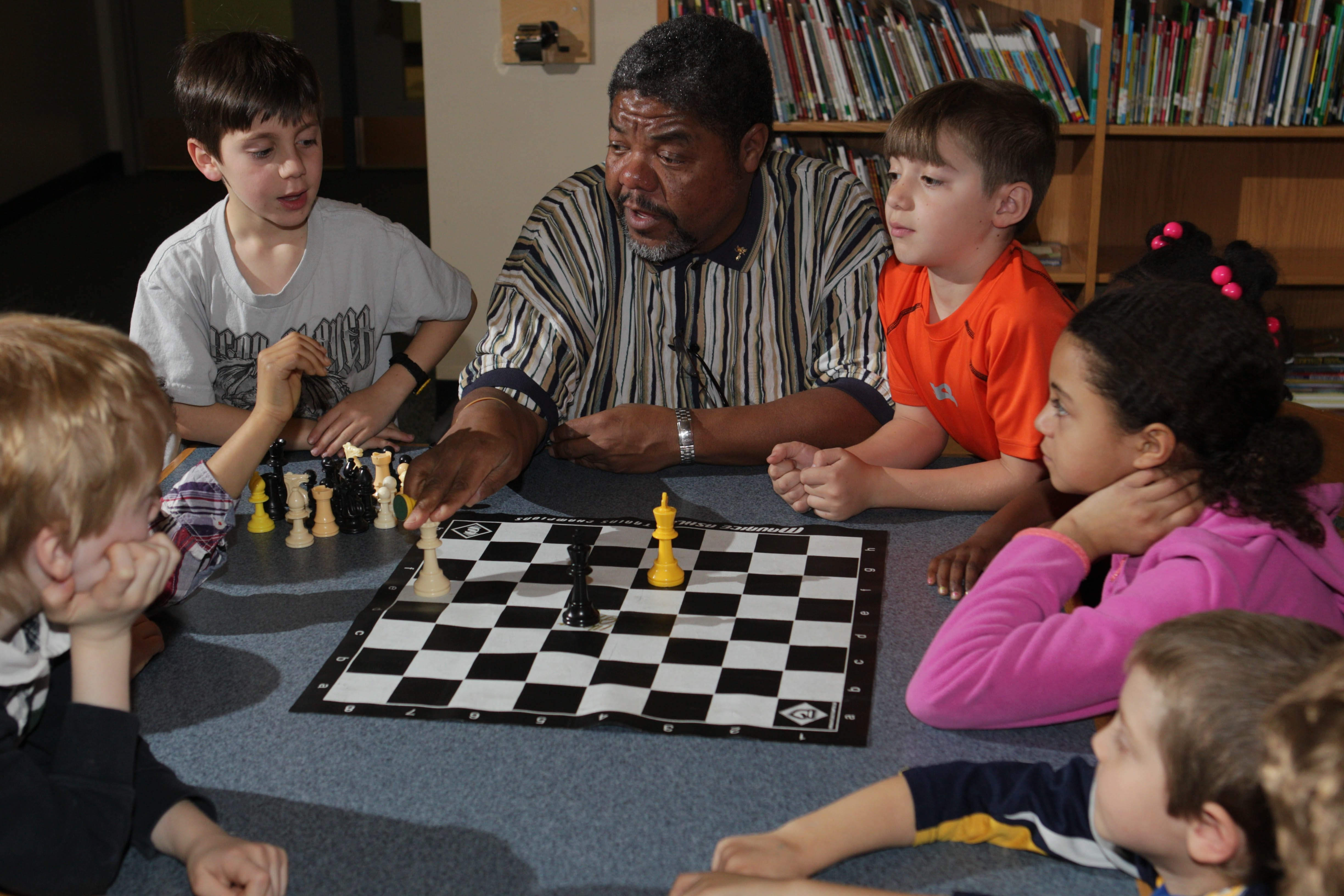 Chessmaster Michael McDuffie of Williamsville coaches kids and adults on the finer points of chess.  Nearly every day of the week, he's at a school, library or community center to teach people how to play chess and encourage them to compete.  Here he's with Wise Scholastic Chess Club for grades k-4 in an after school program two days a week at Olmsted School #64,Wednesday, March 19, 2014. There are about 20 kids in the club. Here, he gives a group lesson. (Sharon Cantillon/Buffalo News)