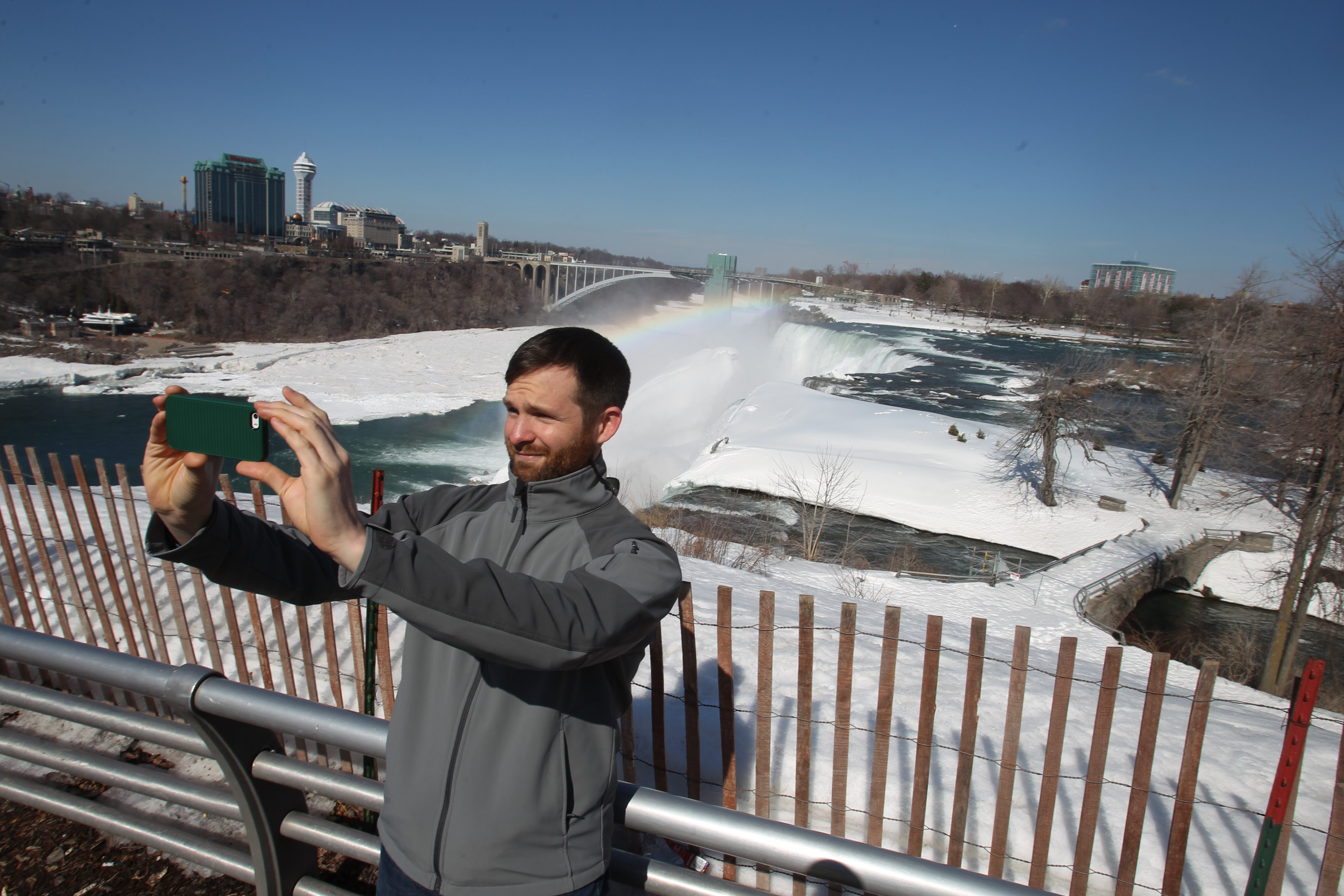 Ohio State fan Robert Metz of Oakland, Calif.,  works on a 'selfie' at  Goat Island in Niagara Falls , Friday. See a photo gallery of how fans spent their time  at Buffalo News.com.