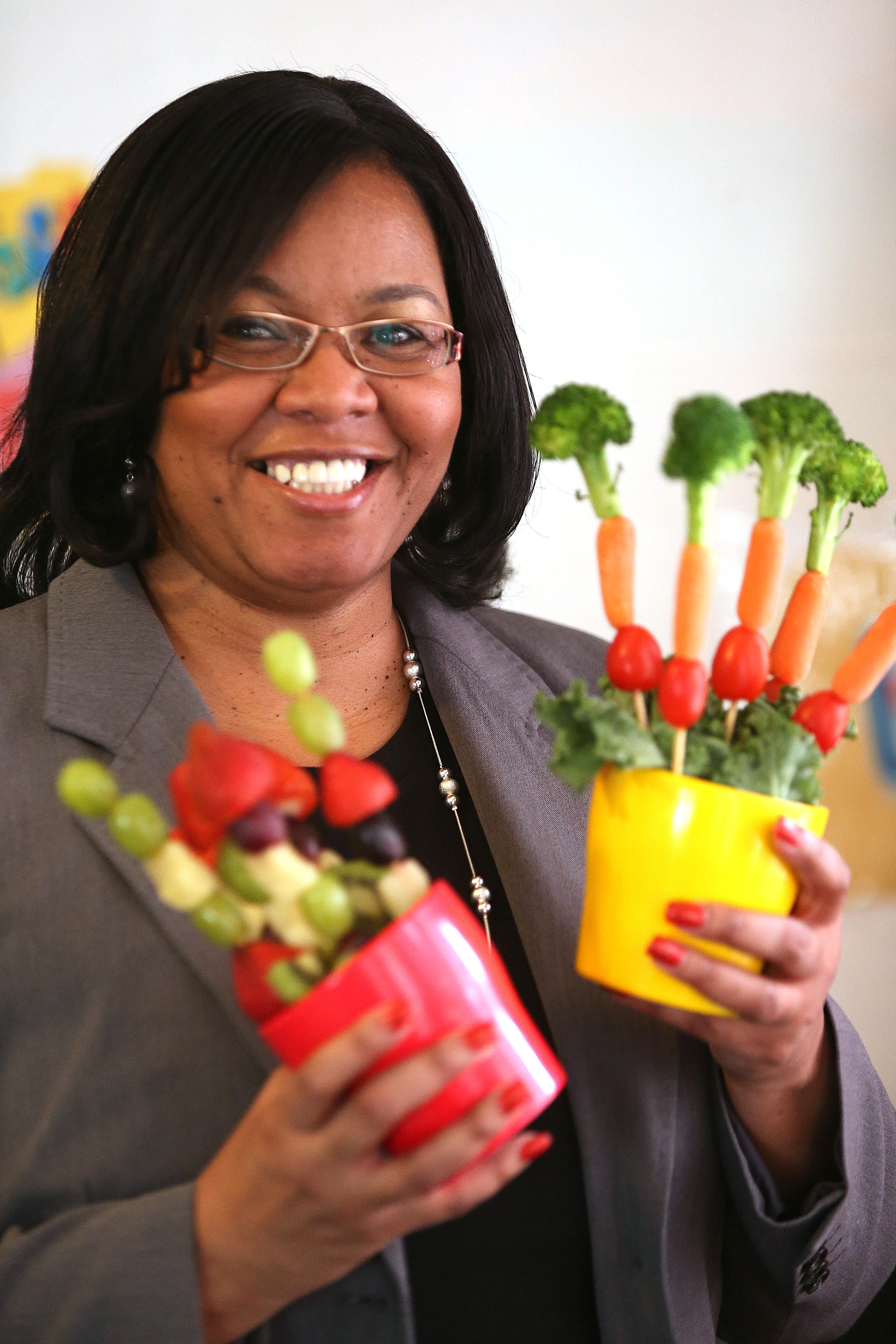 Antoinette Davis with healthy snacks at Something Special Day Care on Monday, March 17, 2014.  (Robert Kirkham/Buffalo News)
