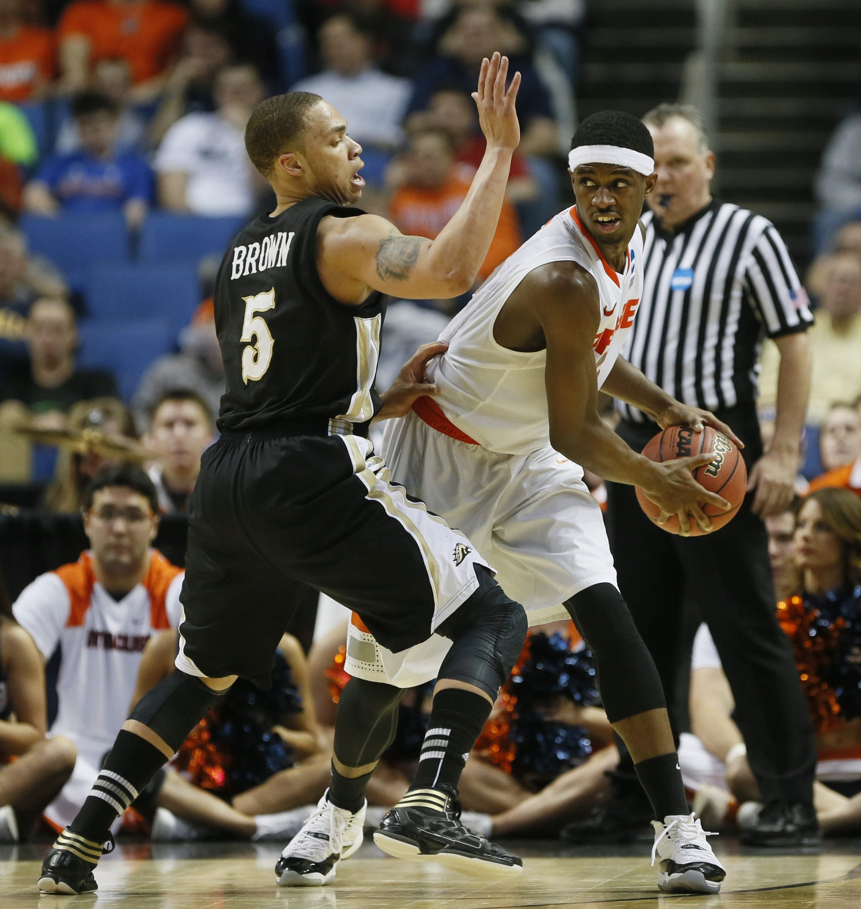 Syracuse's C.J. Fair, right, looks for room against Western Michigan's David Brown during the second half at First Niagara Center. Fair had a game-high 11 rebounds.