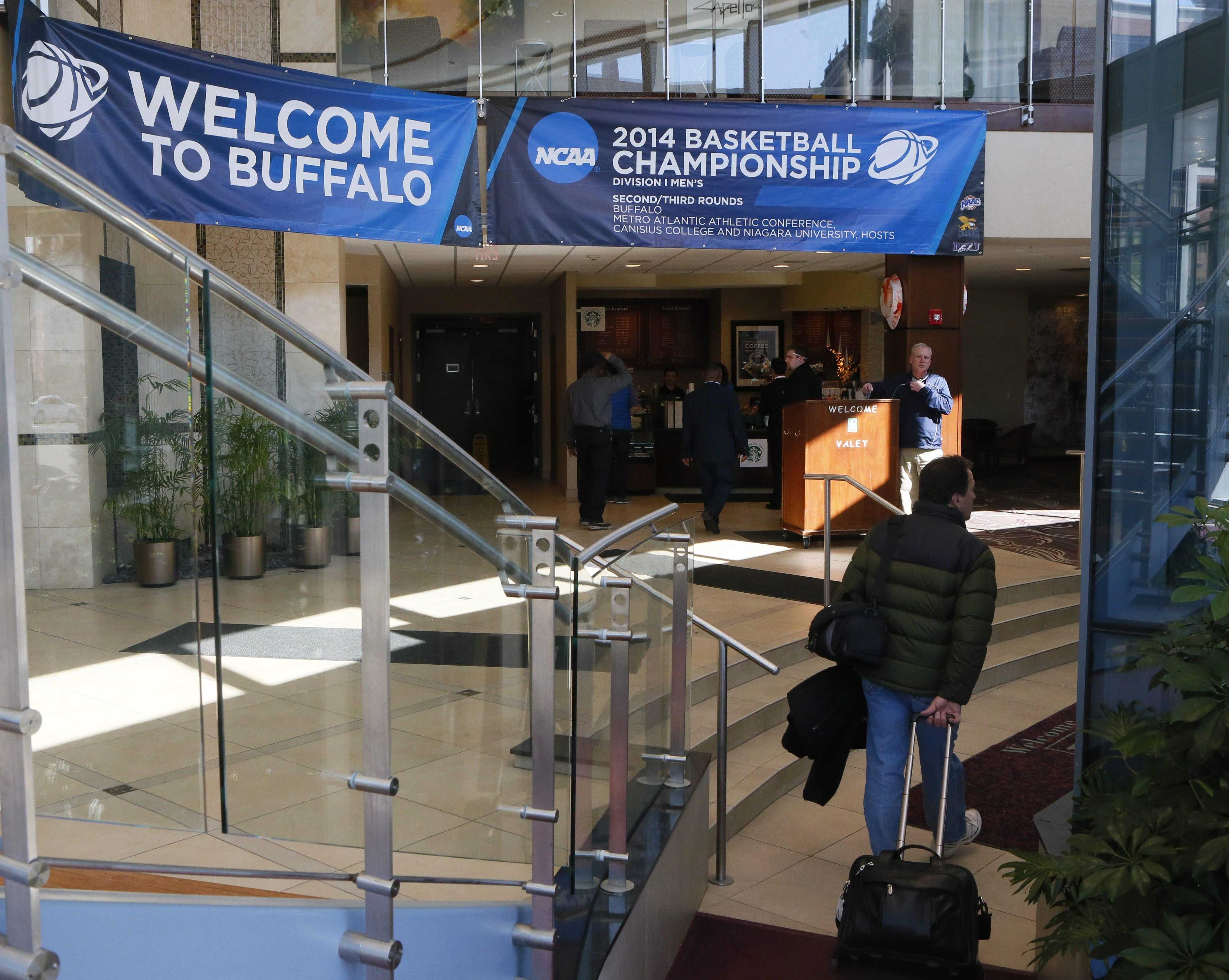 Banners at the Embassy Suites hotel on Delaware Avenue welcome basketball visitors. Sightseers who head north on Delaware will get a look at Millionaires' Row, a vestige of Buffalo's gilded age.