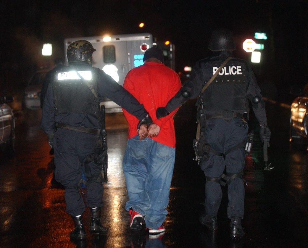 Members of the Niagara Falls Police SWAT team bring out a drug suspect during a raid in 2005. A specially outfitted armored vehicle will allow officers increased protection when accessing crimes in progress.