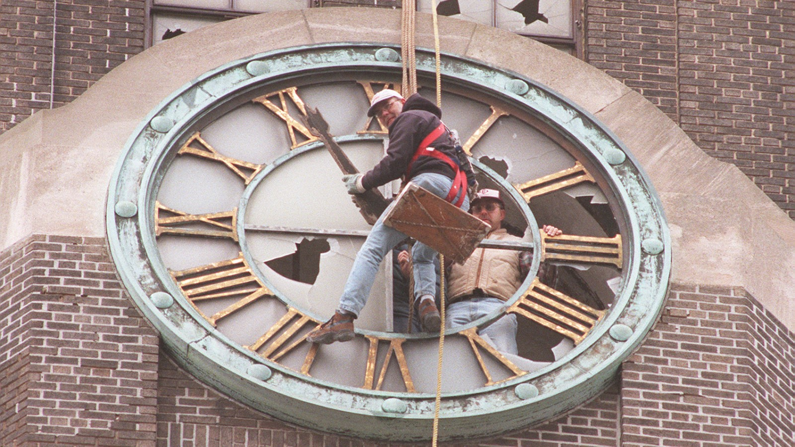 On April 23, 1999, Jeff Ingersoll dangles from the Central Terminal as restoration work began on the clock. Mike Peglau of the Central Terminal Advisory Committee appears beside him. (Buffalo News file photo)