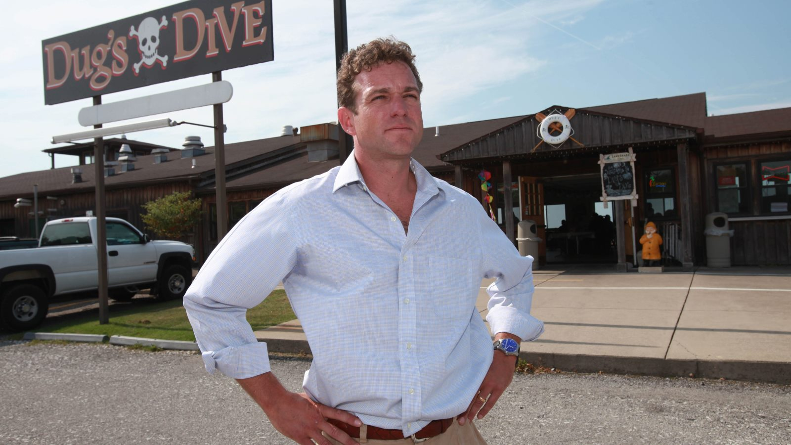 Tucker Curtin, who owns Dug's Dive, stands in front of the restaurant Sept. 24, 2010. (Sharon Cantillon/Buffalo News)