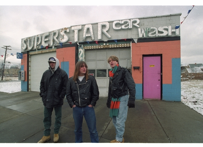From left, original drummer George Tutuska, Robby Takac and Johnny Rzeznik in front of Superstar Car Wash on William Street on Jan. 8, 1993. (Buffalo News file photo)