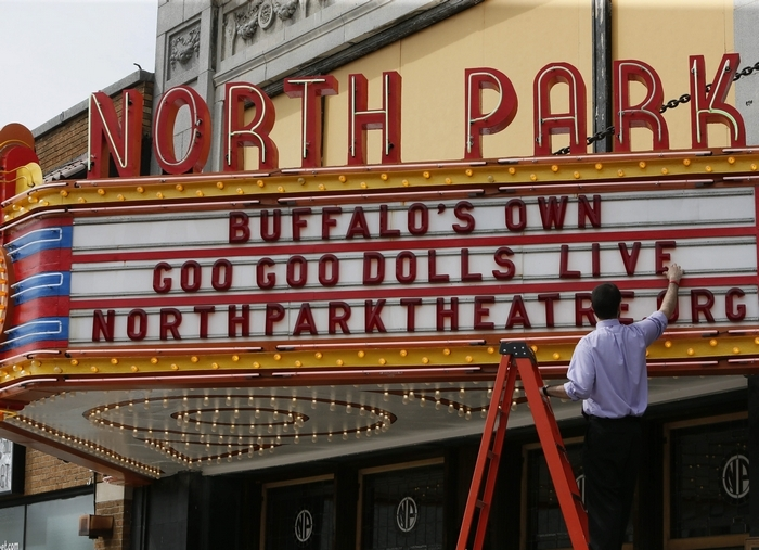 Assistant Manager Vinny Lauricella puts up letters on the marquee at North Park Theatre on Monday. (Derek Gee/Buffalo News)