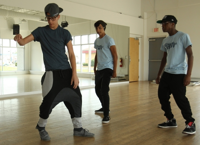 At top, a collection of moves by Tiley Strowzewski. Above, from left, Zach Weaver, Strowzewski and Xavier Drayton at a practice session at Future Dance Center. (Photos by James P. McCoy/Buffalo News)