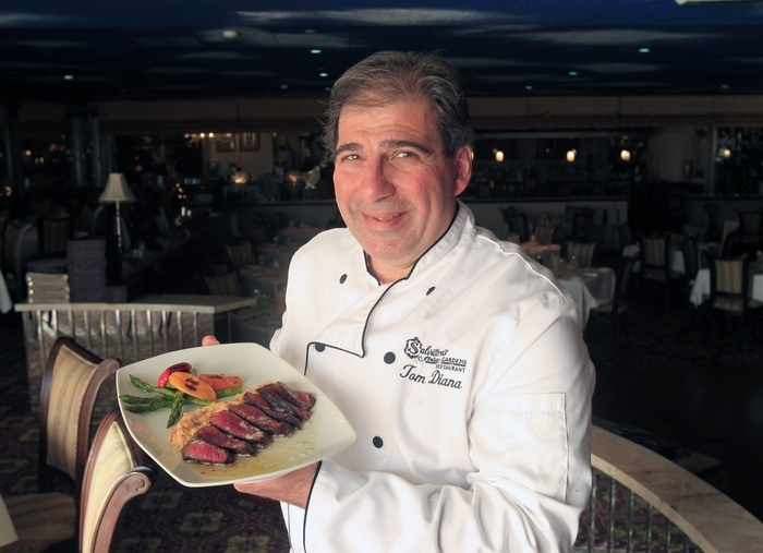 Chef Tom Diana shows off the Wagyu sirloin in Salvatore's. (Harry Scull Jr./Buffalo News)