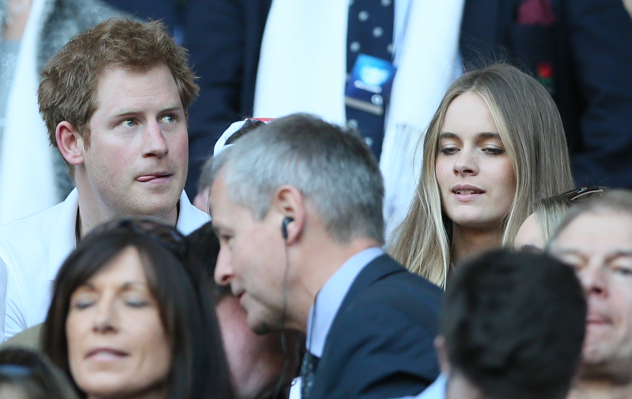Britain's Prince Harry and his girlfriend, Cressida Bonas, right, shown at a rugby match in March, have reportedly split up.
