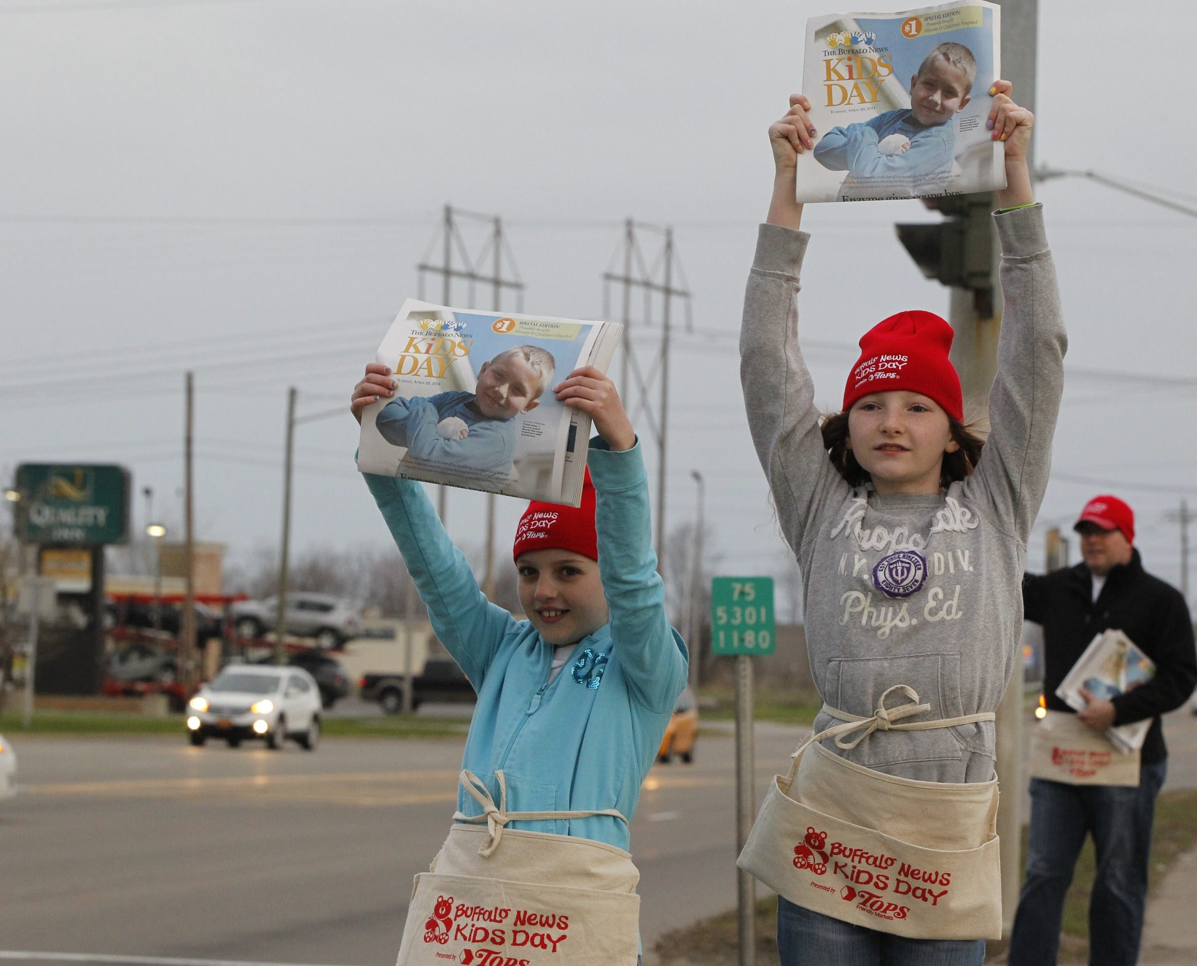 Abby and Emily Buffum sell Kids Day editions of the Buffalo News  along Camp Road in Hamburg.  Harry Scull Jr. /Buffalo News