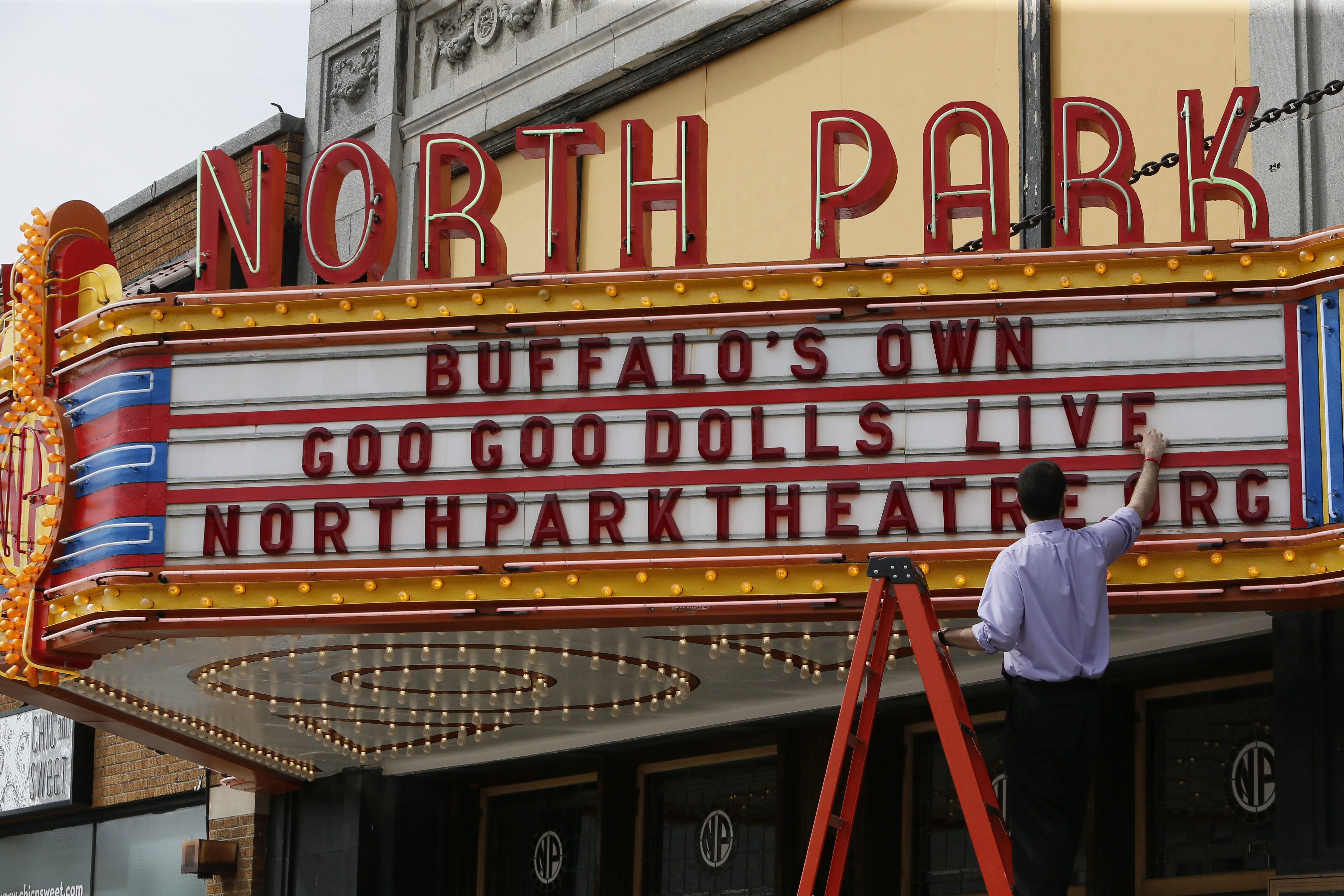 Assistant Manager Vinny Lauricella puts up letters on the marquee at North Park Theatre on Monday.