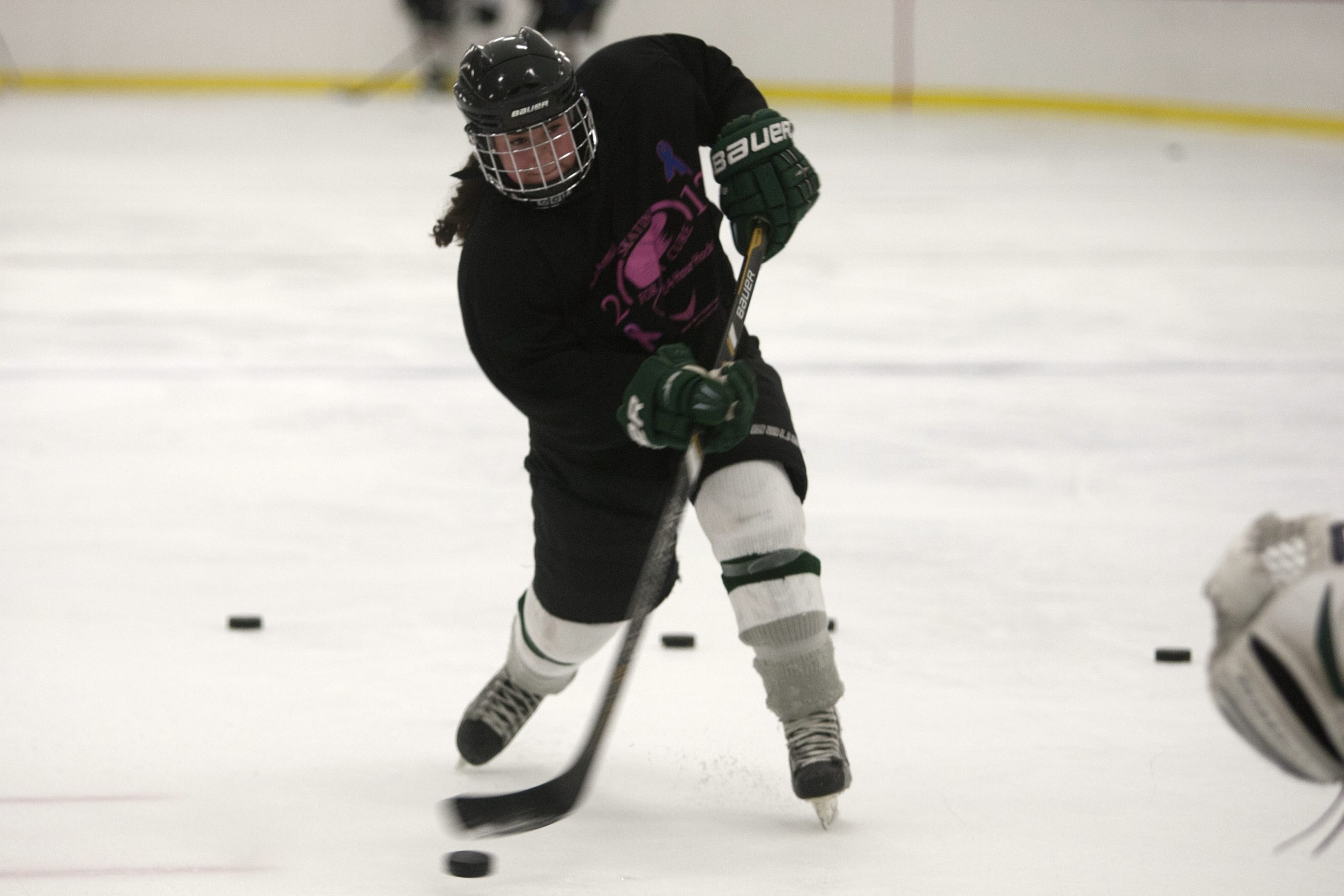 Madison Sansone is among six Nichols seniors who are headed to play elite-level college hockey.