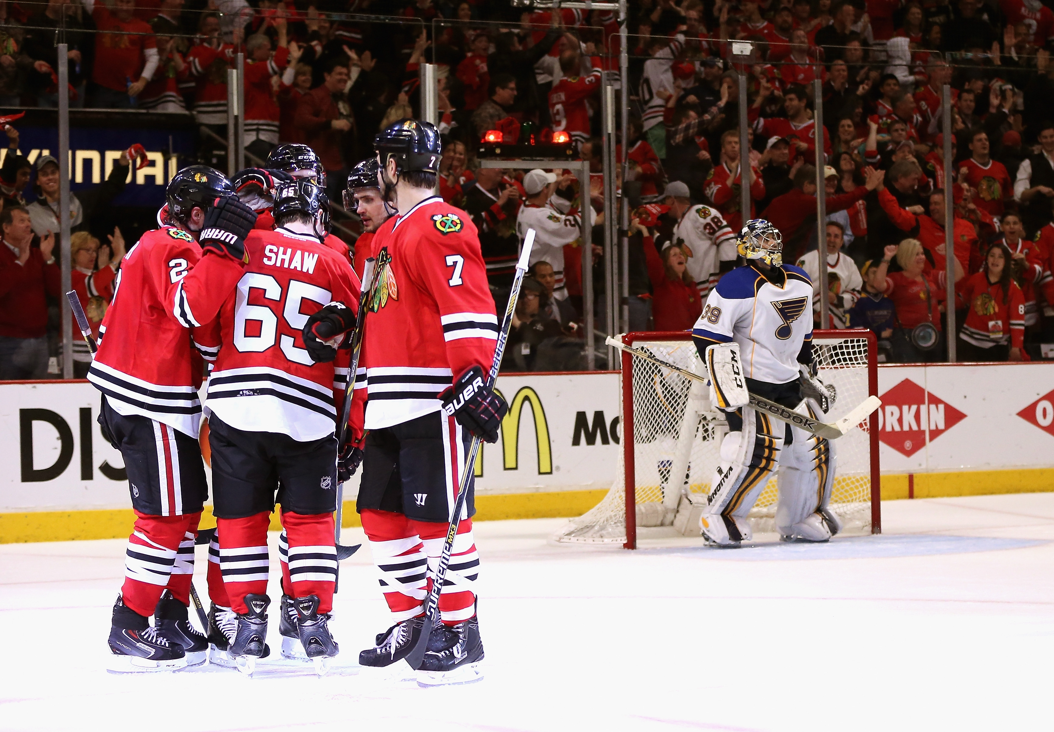 Members of the Blackhawks celebrate Duncan Keith's third-period goal against Ryan Miller and the Blues.