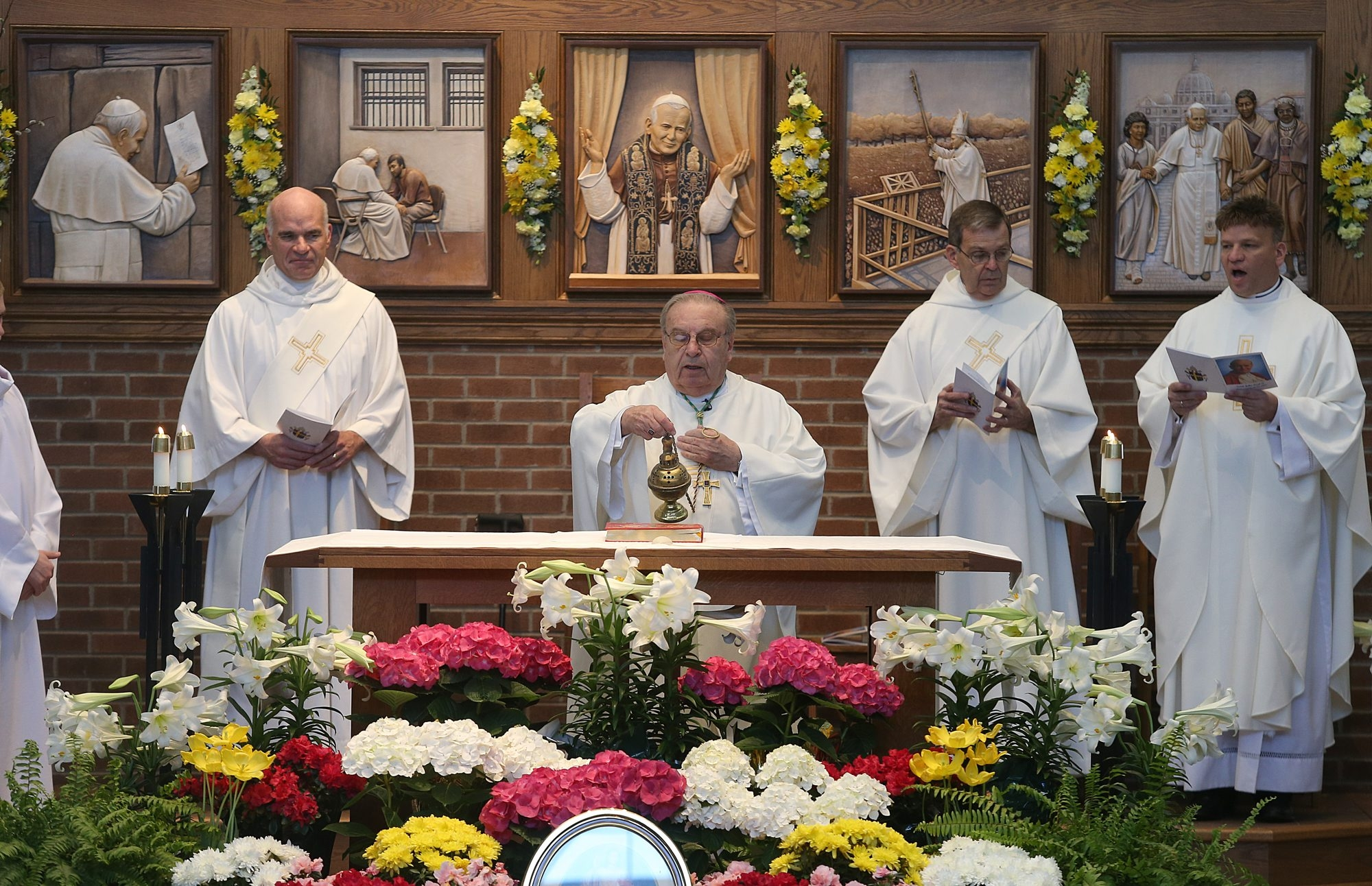Bishop Edward Kmiec, center, presides over a special Mass dedicated to the late Pope John Paul II at St. John Paul II Church in Lake View on April 27.  Bishop Edward Kmiec, center, presides over a special Mass dedicated to the late Pope John Paul II at St. John Paul II Church in Lake View.