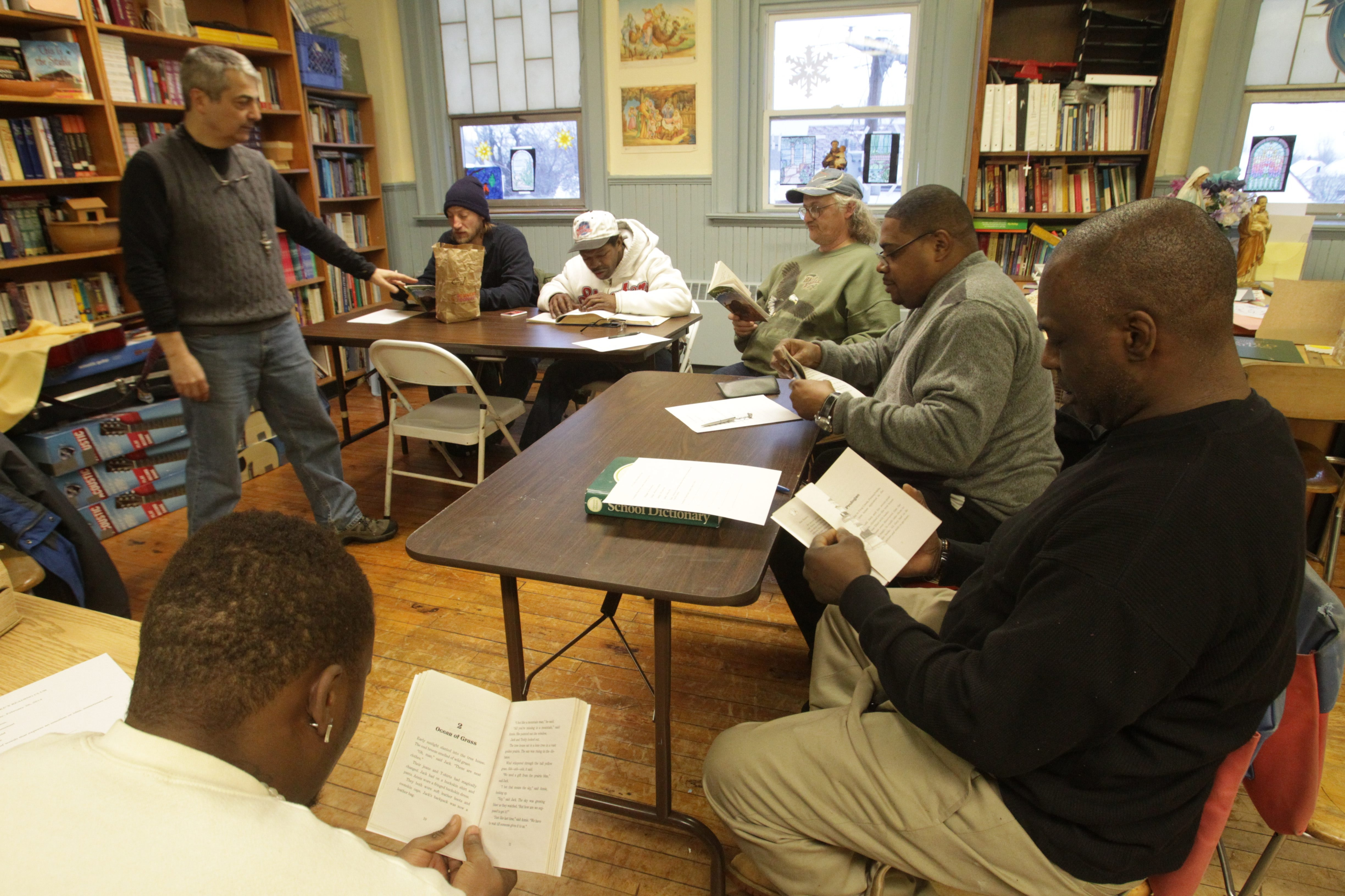 Mike Taheri teaches group of men to read at St. Luke's Mission of Mercy in Buffalo. The adult reading group is helping many people who have struggled in their lives because they have very little education.