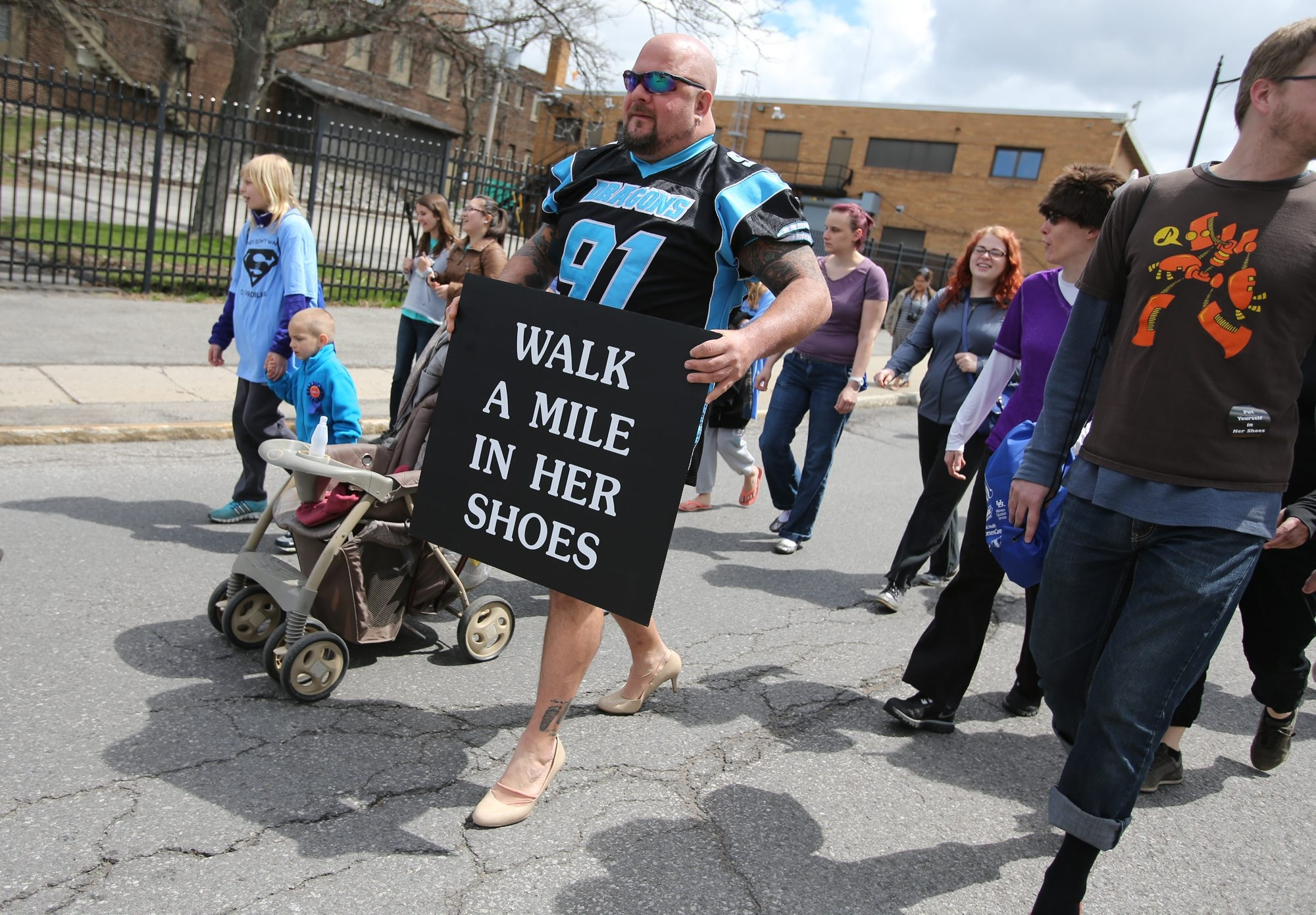 Mike Coe wears some stylish pumps while participating in the Walk a Mile in Her Shoes event.