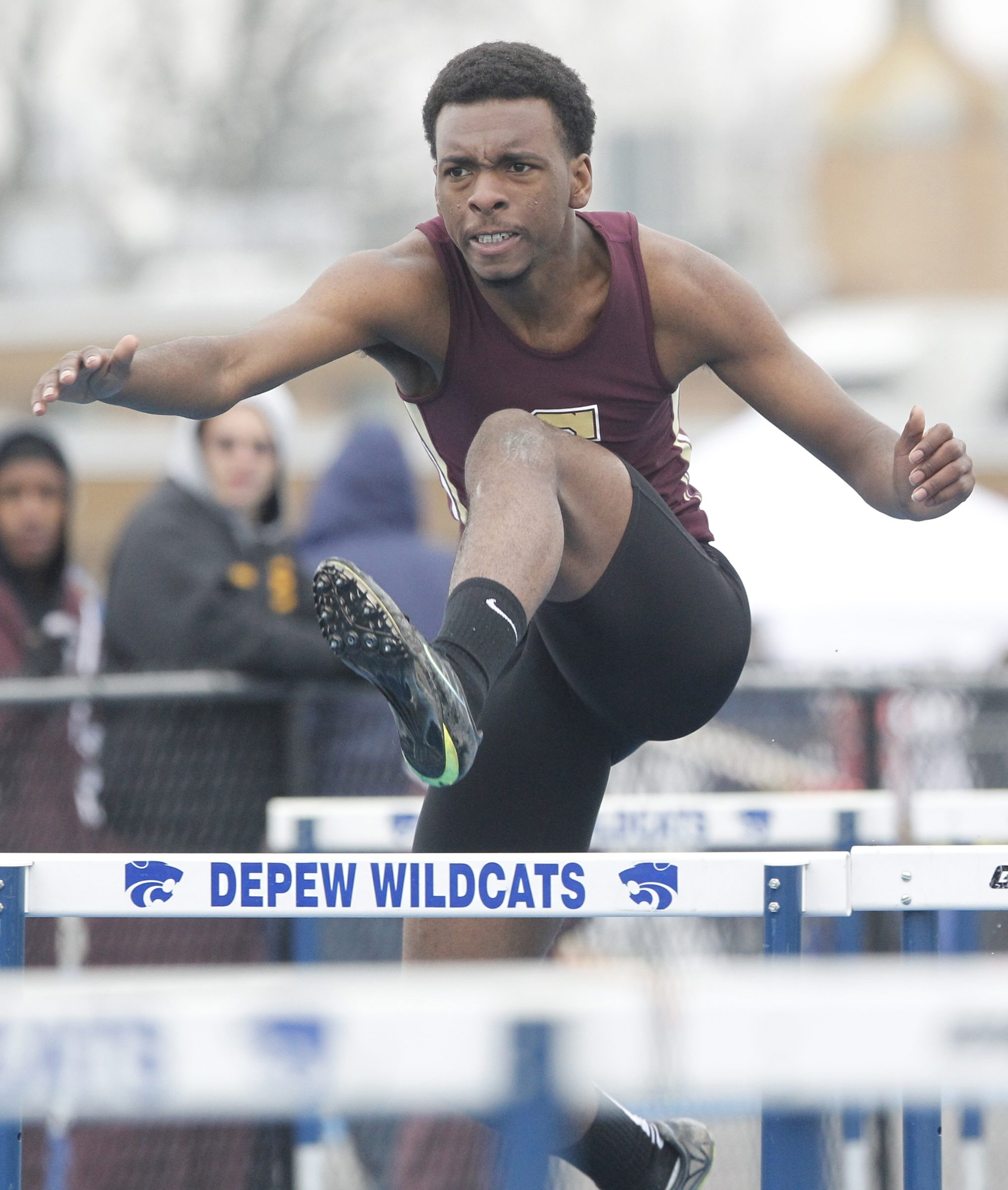 Joe Sudderth from Cheektowaga High school jumps a hurdle during Heat 3 of the Shuttle relay race during the Depew Wildcat relays at Depew high school on, Saturday, April 26, 2014. {Photo by Harry Scull Jr. /Buffalo News}