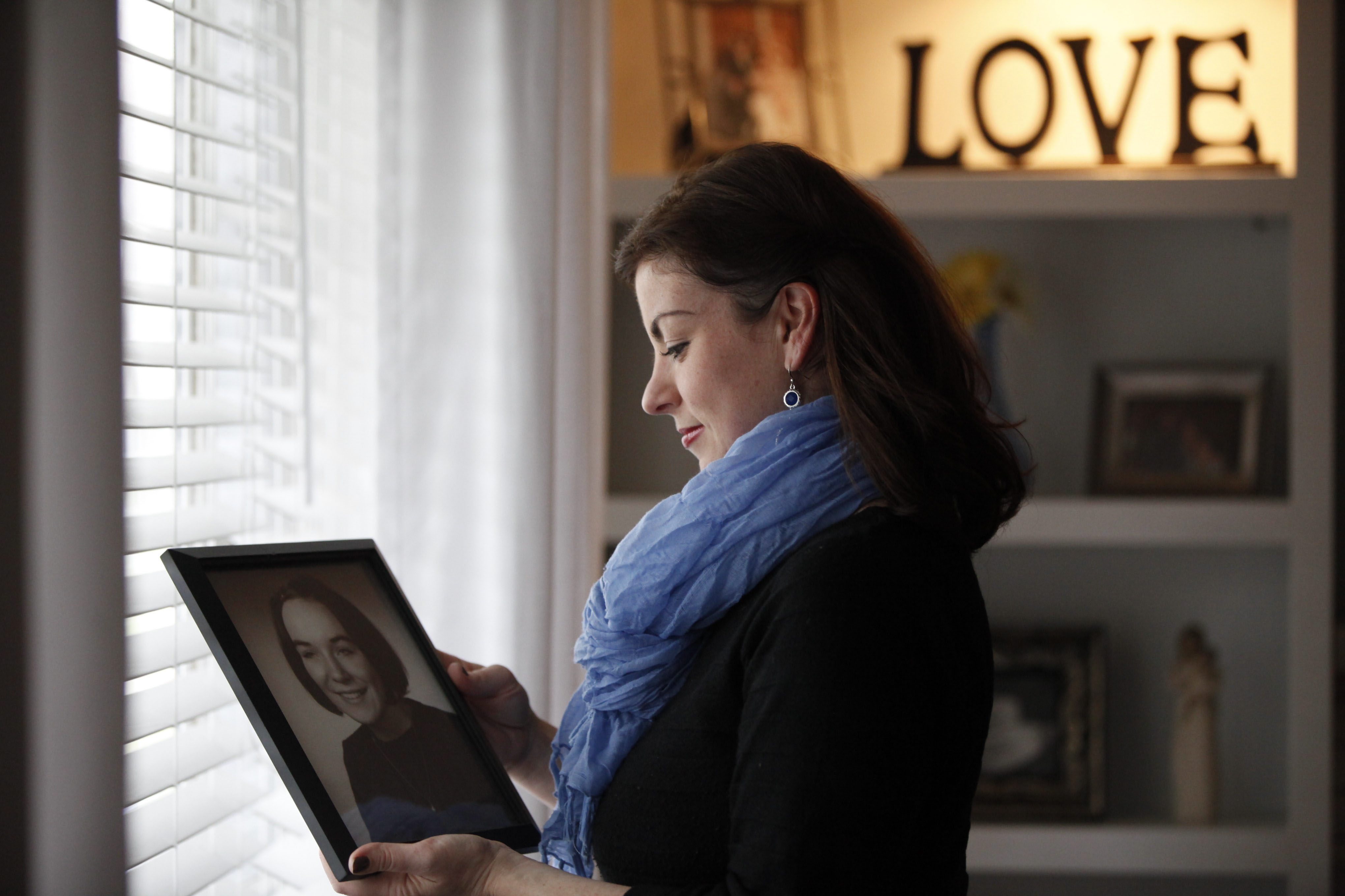 Tess Fraser, organizer of the Undy 5000, hopes the 5K race to be held Saturday in Delaware Park will raise awareness about colon cancer, which claimed the life of her mother, Barbara Hogg, in 2012. (Harry Scull Jr./Buffalo News)