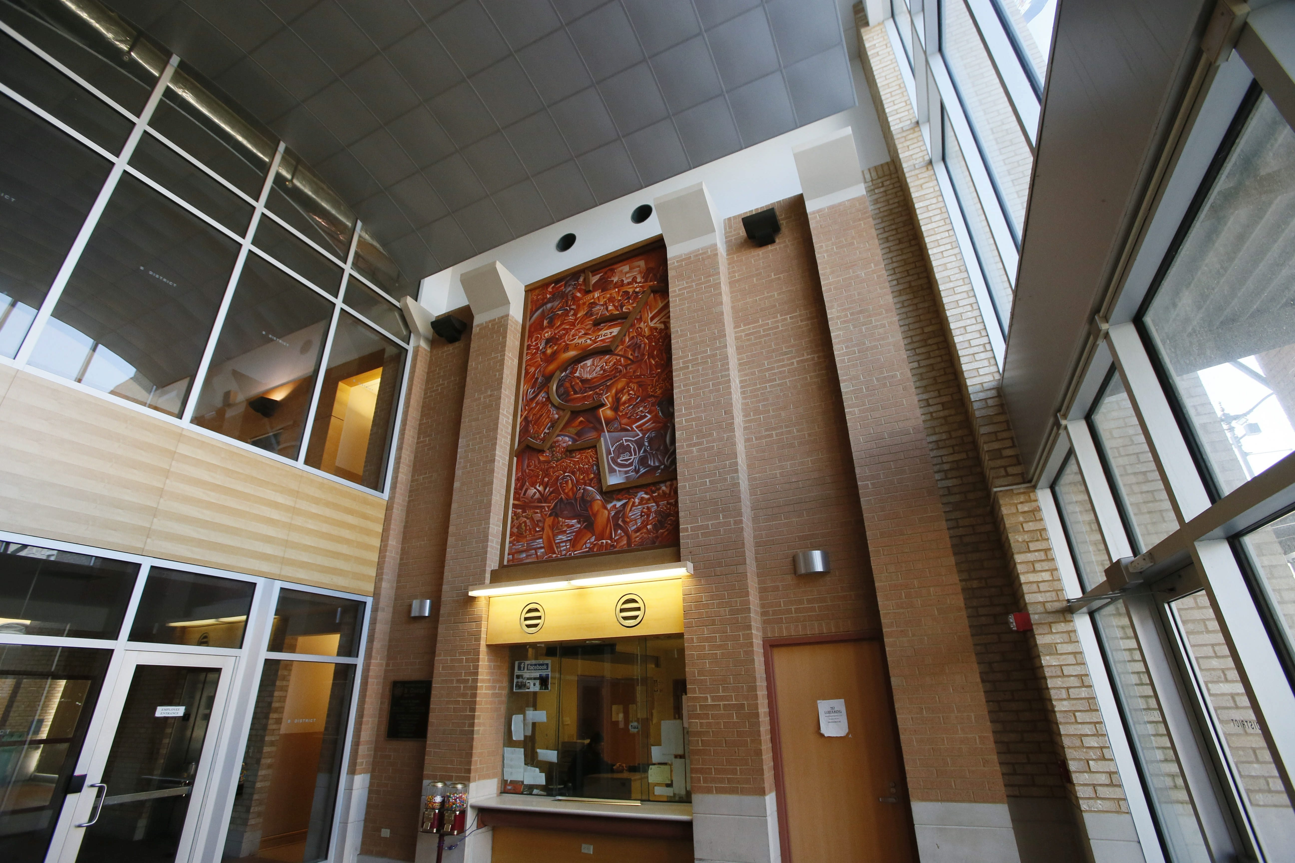 An artist's mural rises toward the ceiling in the lobby of the B District station in downtown Buffalo.