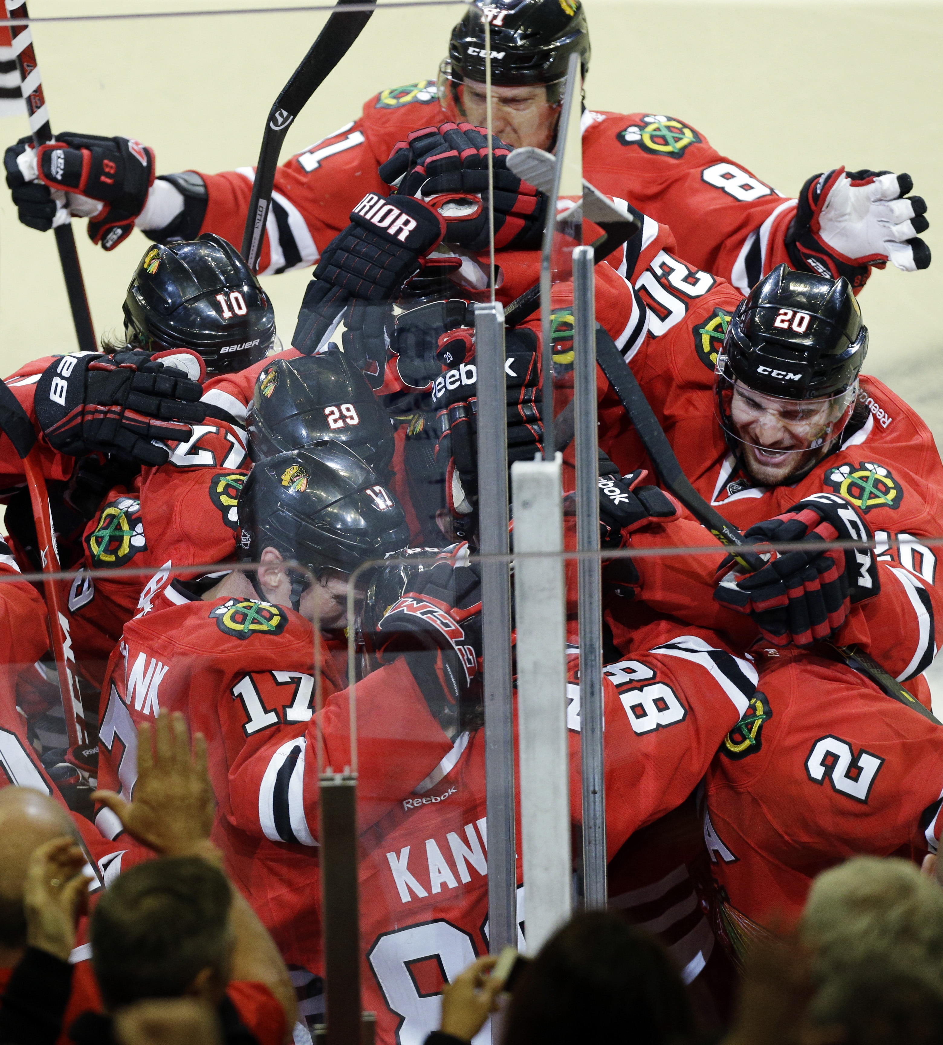 The Blackhawks' Patrick Kane (88) celebrates with teammates after scoring the game-winning goal during overtime in Game Four to tie the first-round playoff series against the St. Louis Blues.