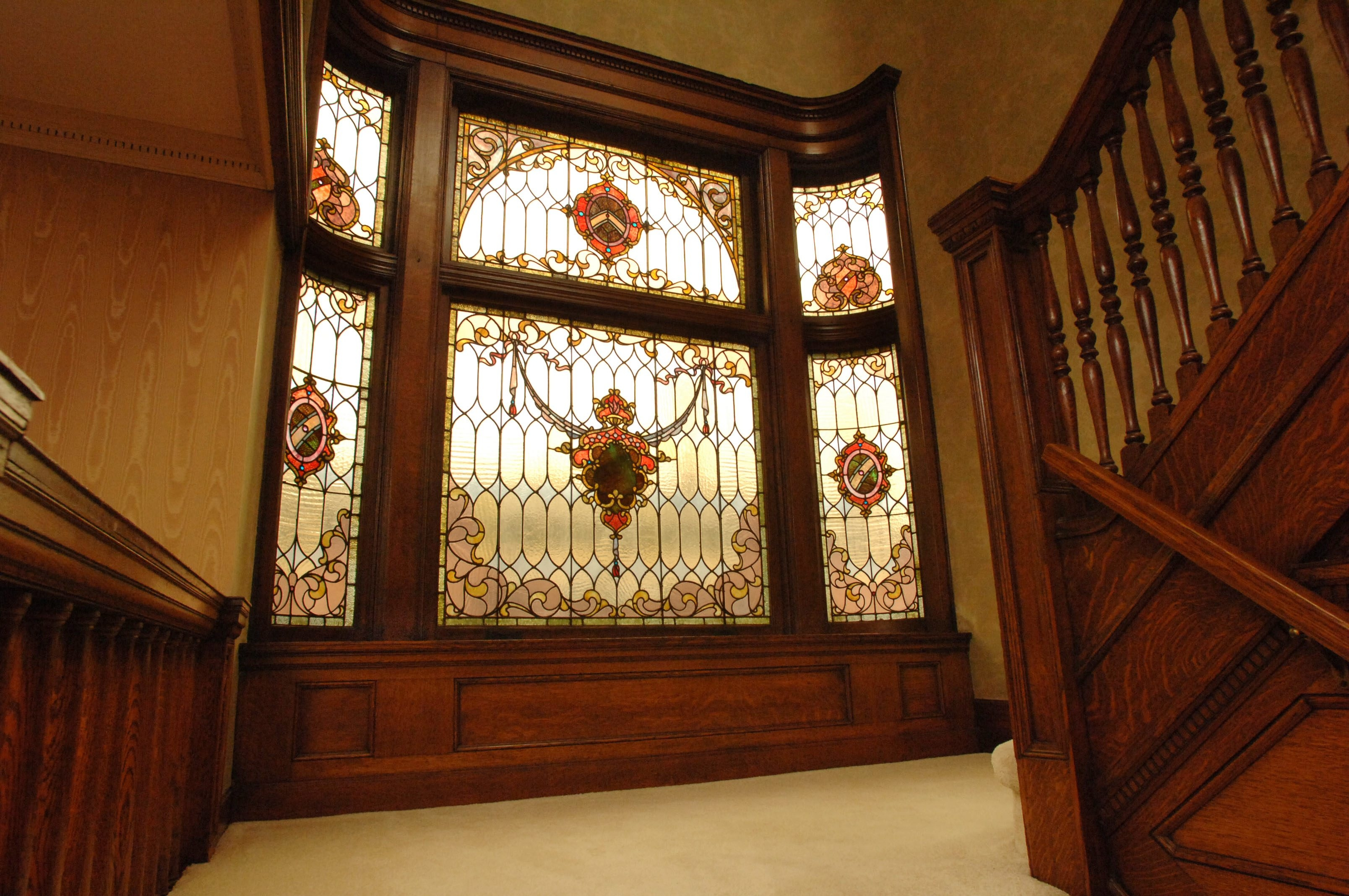 Tour time: A staircase with stained-glass windows is one of the highlights of James Mack's 121-year-old Queen Anne, one of 10 homes to be open during the Historic Linwood Tour of Homes on May 4. This Second Empire home, above left, also is on the Linwood tour. The porch becomes a gathering place at the home of Ken and Phyllis Wells, left. The house will be featured in the 16th annual Parkside Tour of Homes on May 18.