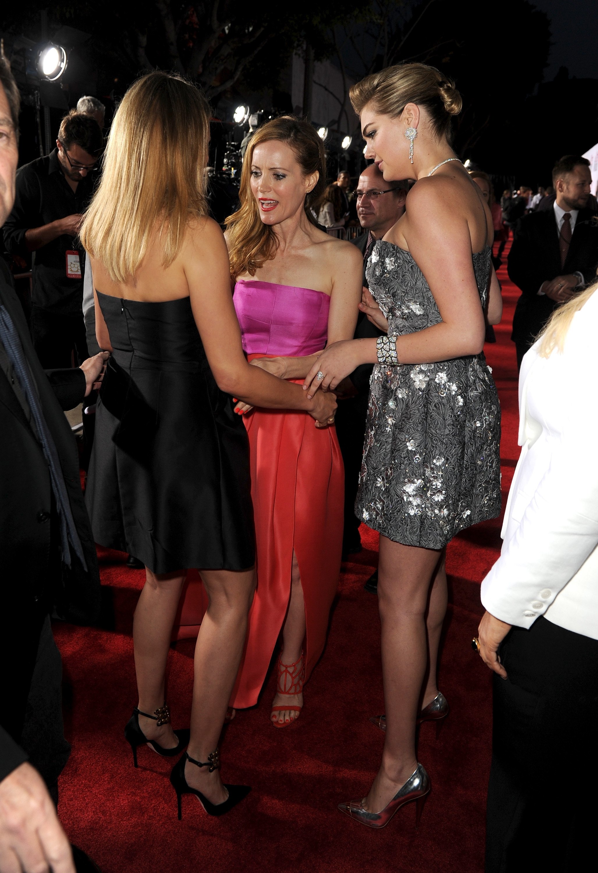 """Actors Cameron Diaz, back to camera, Leslie Mann and Kate Upton attend the premiere of """"The Other Woman"""" on Wednesday in Westwood, Calif."""