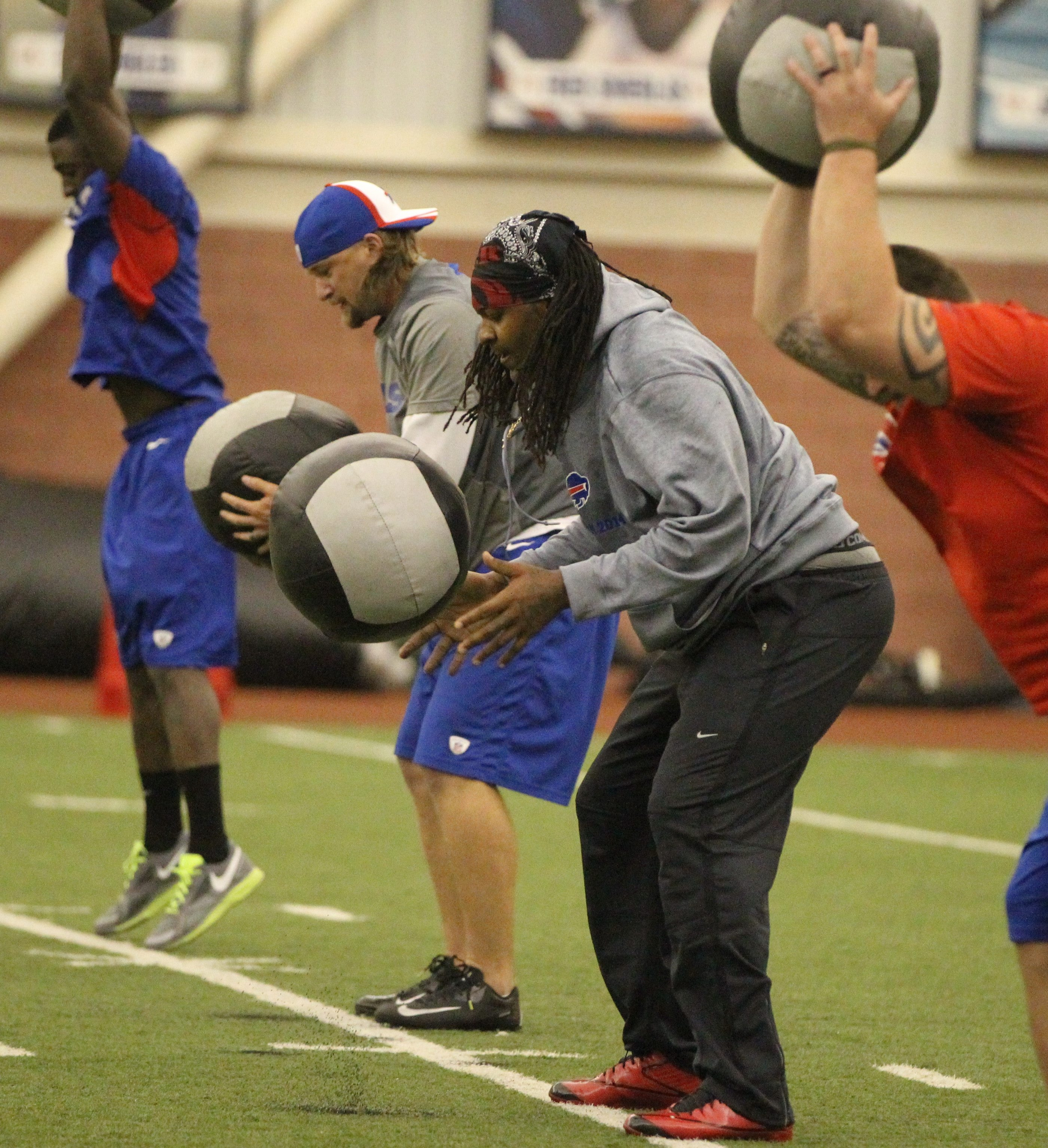 Brandon Spikes does an upper-body drill during the first day of voluntary workouts at the HealthyZone Fieldhouse.